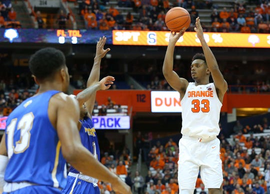 Syracuse forward Elijah Hughes (33) shoots the ball against the Morehead State on Saturday night. Hughes finished with 21 points.