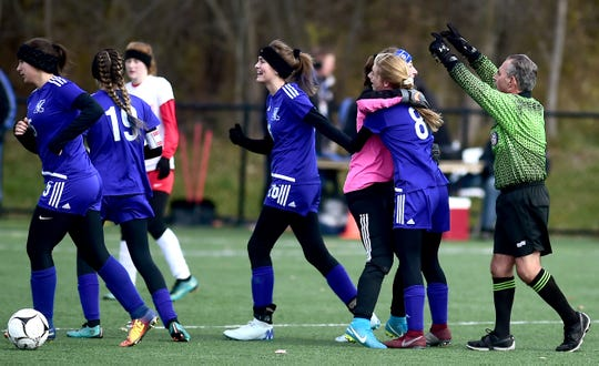 Kendall celebrates after winning the state Class D girls soccer championship on Nov. 11, 2018.