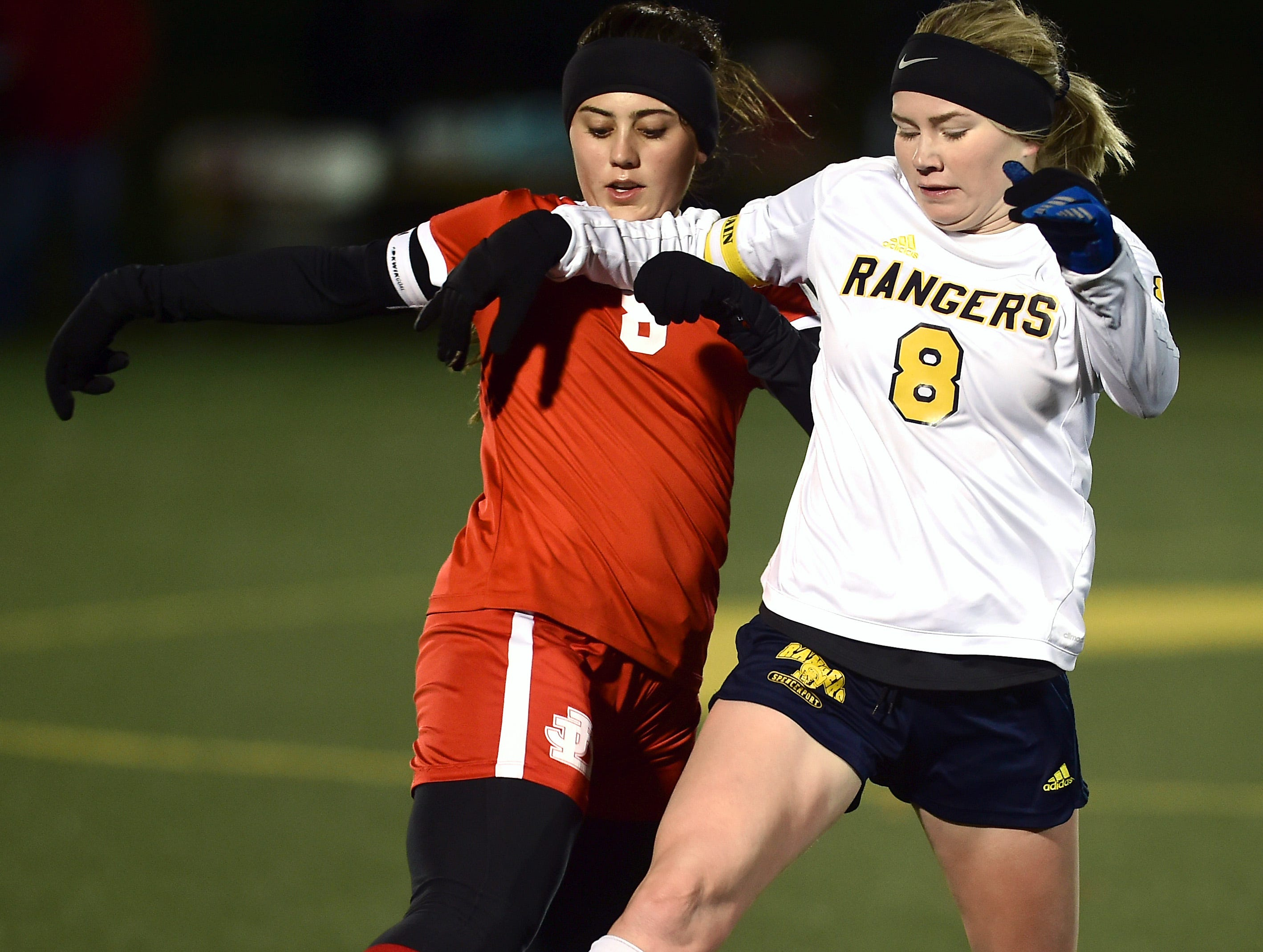 Jamesville-DeWitt's Sydney Tanner (8) and Spencerport's Leah Wengender (8) battle to control ball during first half of action in the Class A NYSPHSAA Girls Soccer Championship semifinal at Tompkins Cortland Community College on Nov. 10, 2018.