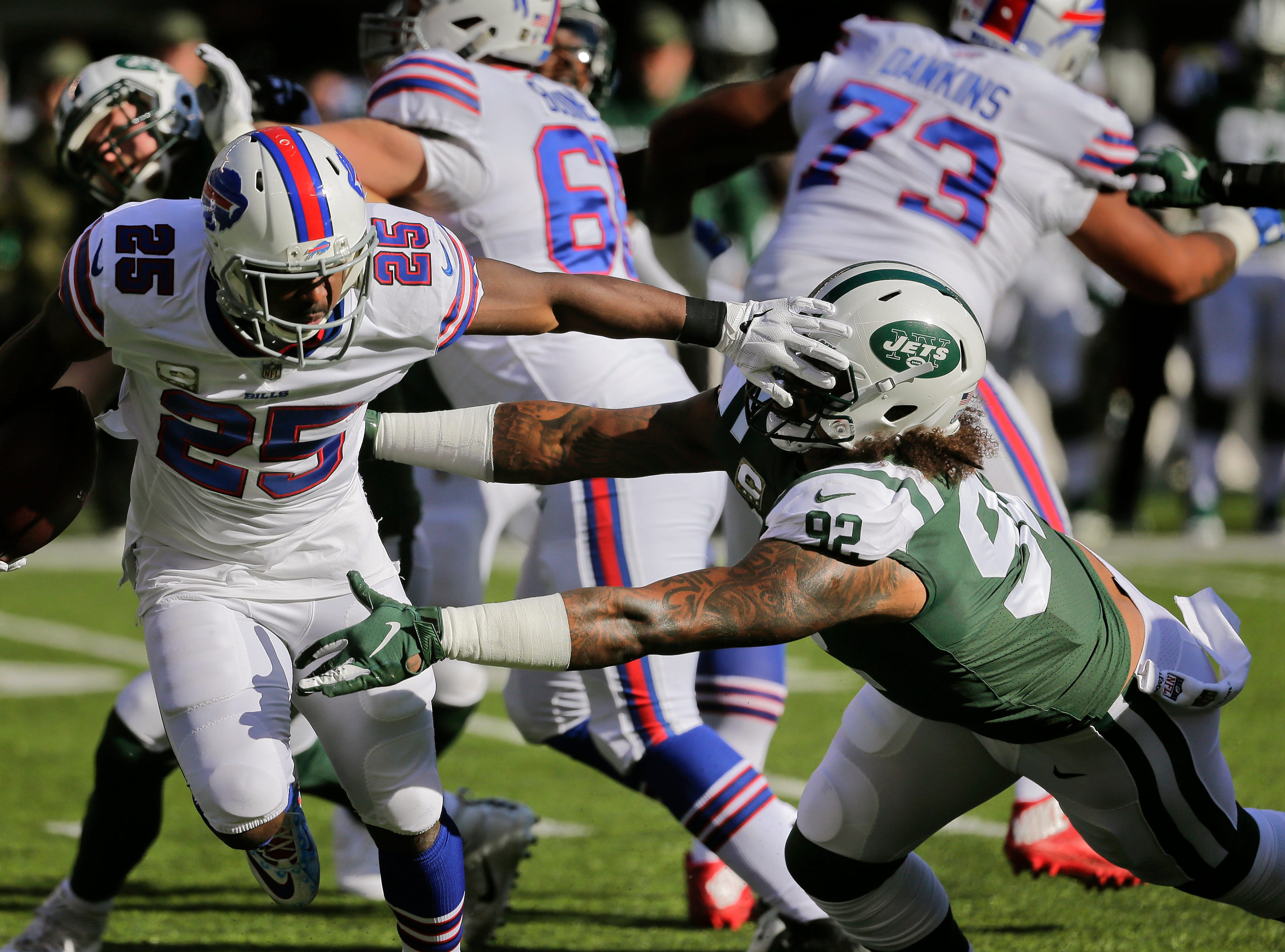 Buffalo Bills running back LeSean McCoy (25) stiff-arms New York Jets defensive end Leonard Williams (92) during the first quarter of an NFL football game, Sunday, Nov. 11, 2018, in East Rutherford, N.J. (AP Photo/Seth Wenig)