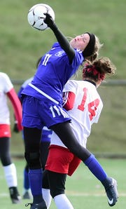 Kendall's Grace Robinson (11) and Fort Ann's Natalie VanKirk (14) battle for the ball during Kendall's 1-0 victory in the state Class D girls soccer championship game.