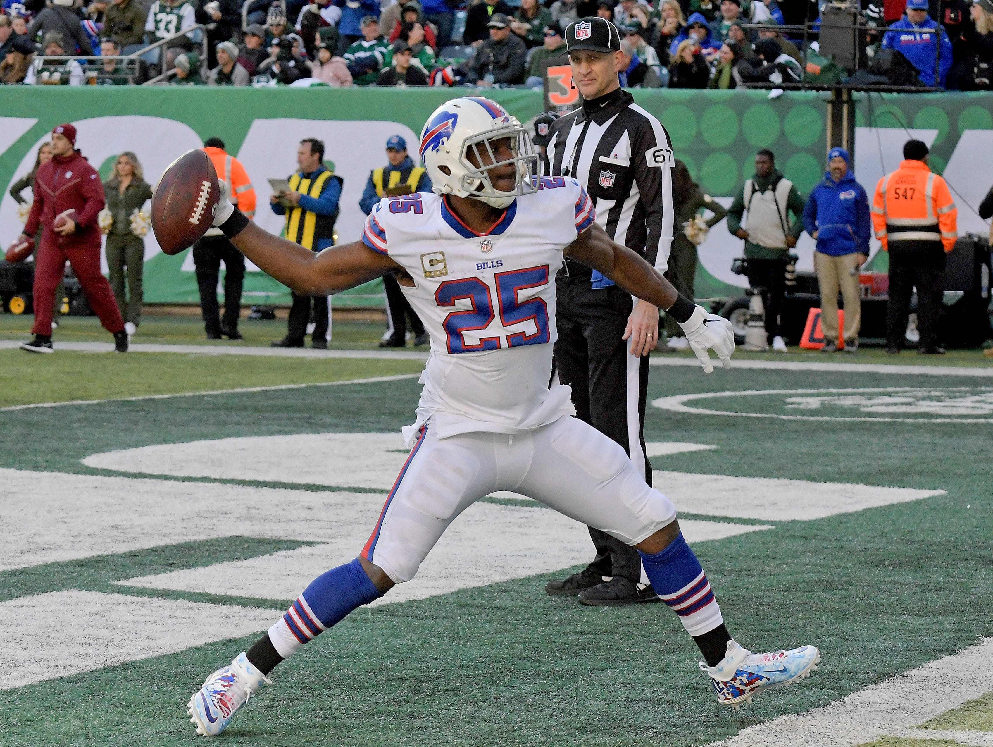 Buffalo Bills running back LeSean McCoy (25) celebrates after scoring a touchdown against the New York Jets during the second quarter of an NFL football game, Sunday, Nov. 11, 2018, in East Rutherford, N.J. (AP Photo/Bill Kostroun)