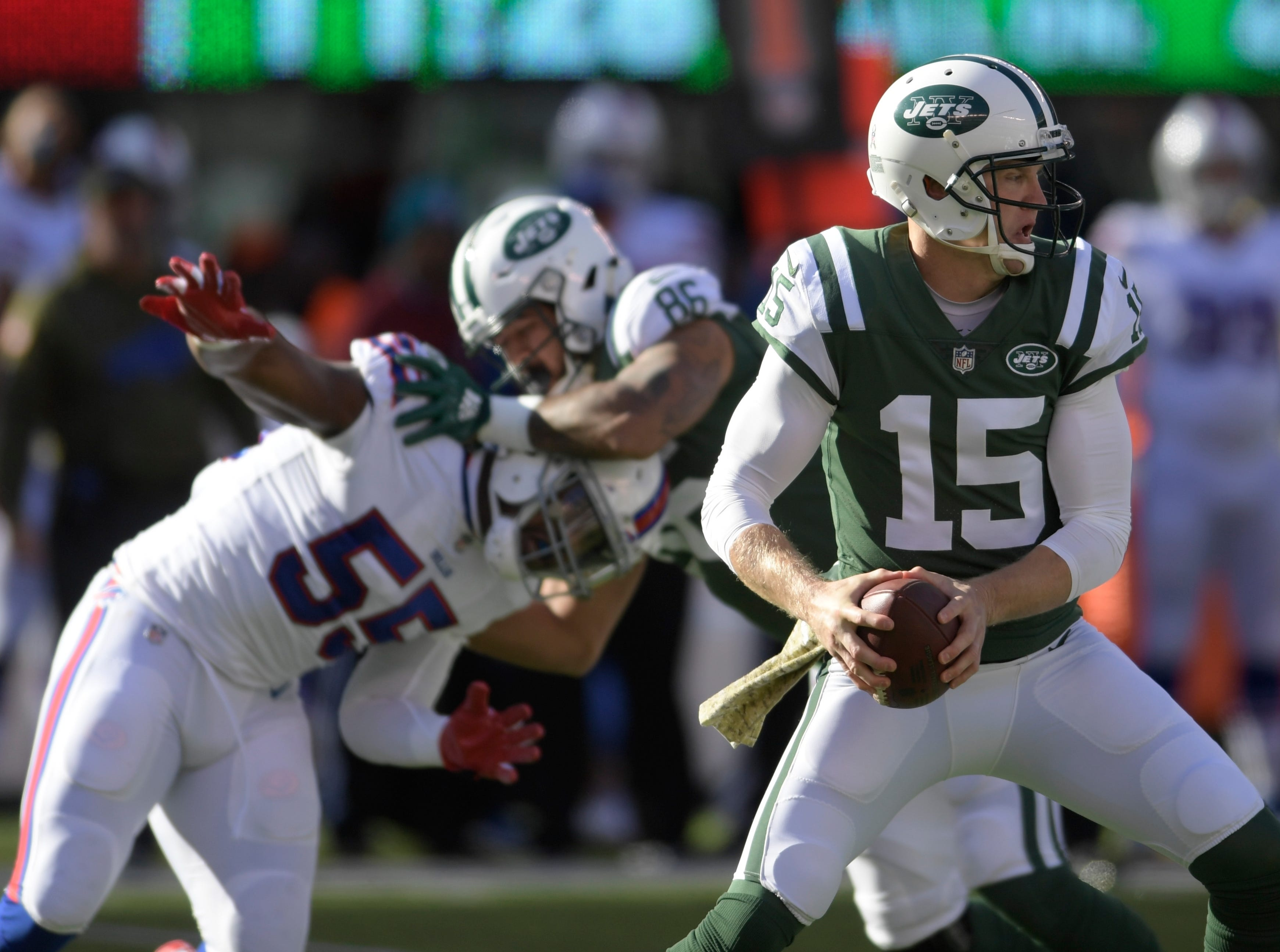 New York Jets quarterback Josh McCown (15) rolls out of the pocket during the first quarter of an NFL football game against the Buffalo Bills, Sunday, Nov. 11, 2018, in East Rutherford, N.J. (AP Photo/Bill Kostroun)