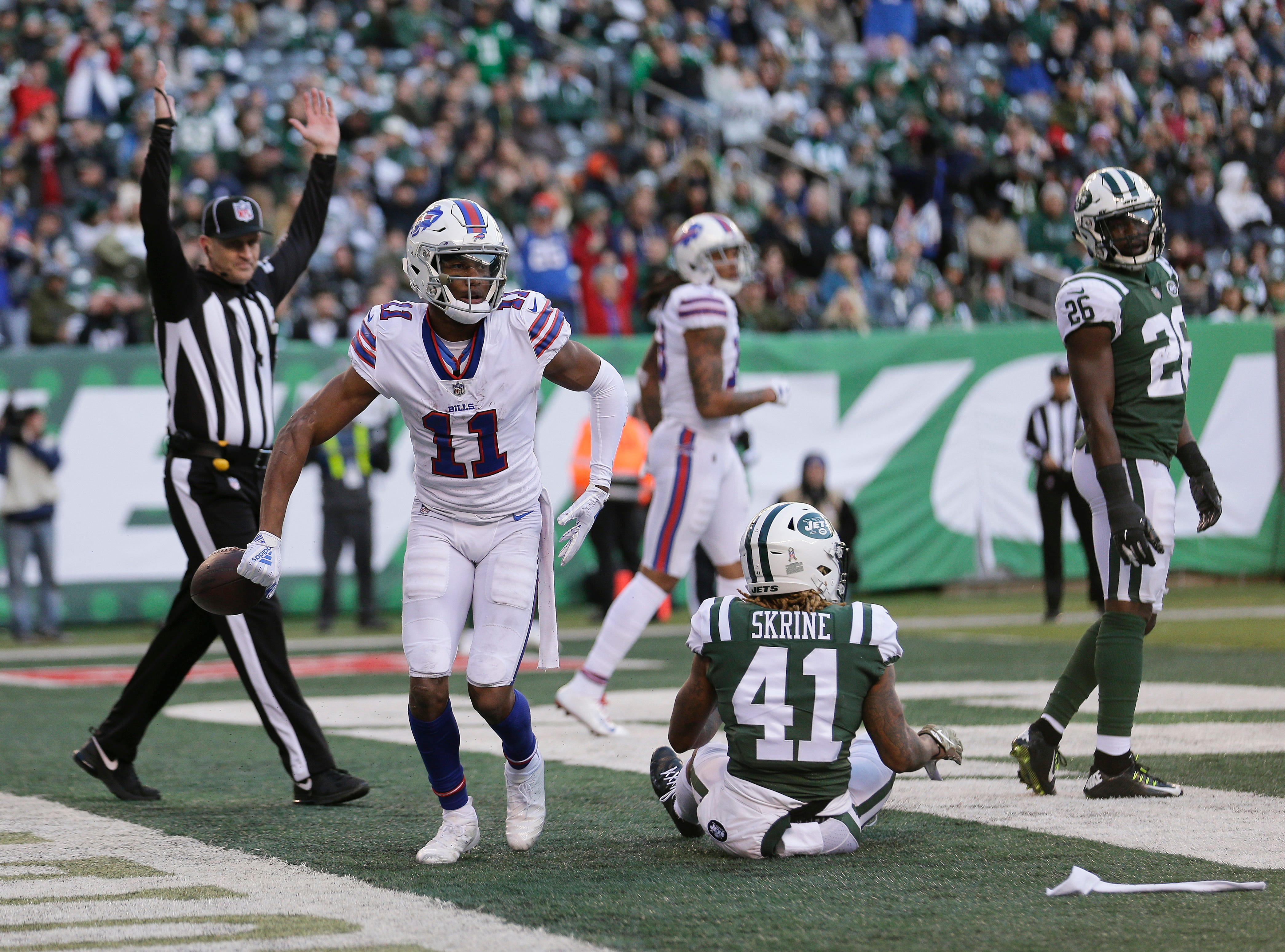Buffalo Bills wide receiver Zay Jones (11) tosses the ball aside after scoring a touchdown against New York Jets cornerback Buster Skrine (41) during the third quarter of an NFL football game, Sunday, Nov. 11, 2018, in East Rutherford, N.J. (AP Photo/Seth Wenig)