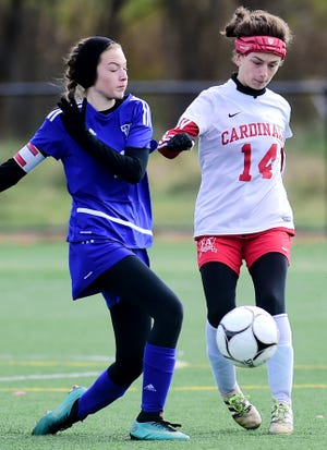 Kendall's Brianna Wakefield, left, and Fort Ann's Natalie VanKirk (14) battle for possession during Kendall's 1-0 victory in the state Class D girls soccer championship game at Tompkins Cortland Community College on Sunday.