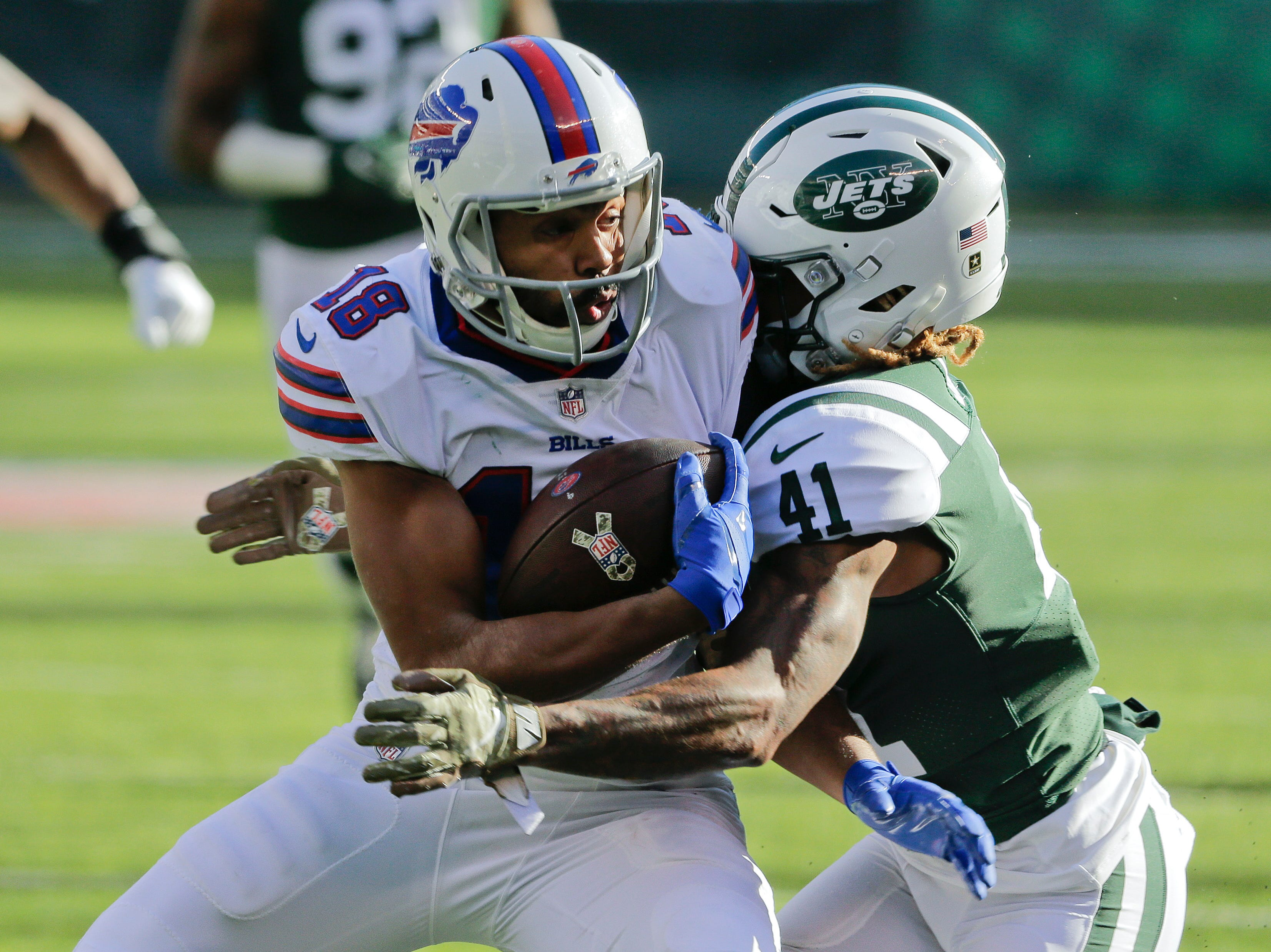 Buffalo Bills wide receiver Andre Holmes (18) takes a hit from New York Jets cornerback Buster Skrine (41) during the second quarter of an NFL football game, Sunday, Nov. 11, 2018, in East Rutherford, N.J. (AP Photo/Seth Wenig)
