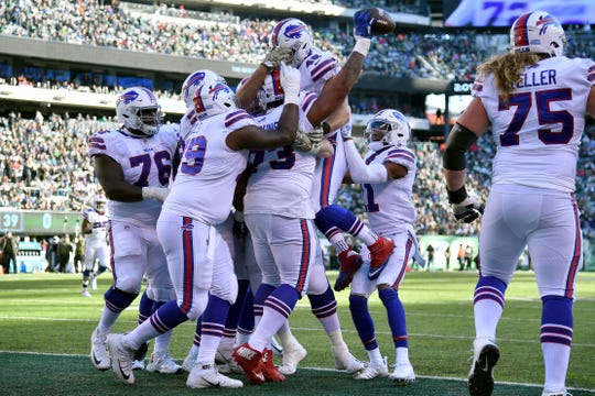 EAST RUTHERFORD, NEW JERSEY - NOVEMBER 11: Dion Dawkins #73 of the Buffalo Bills is congratulated by his teammates after scoring a second quarter receiving touchdown against the New York Jets at MetLife Stadium on November 11, 2018 in East Rutherford, New Jersey. (Photo by Mark Brown/Getty Images)