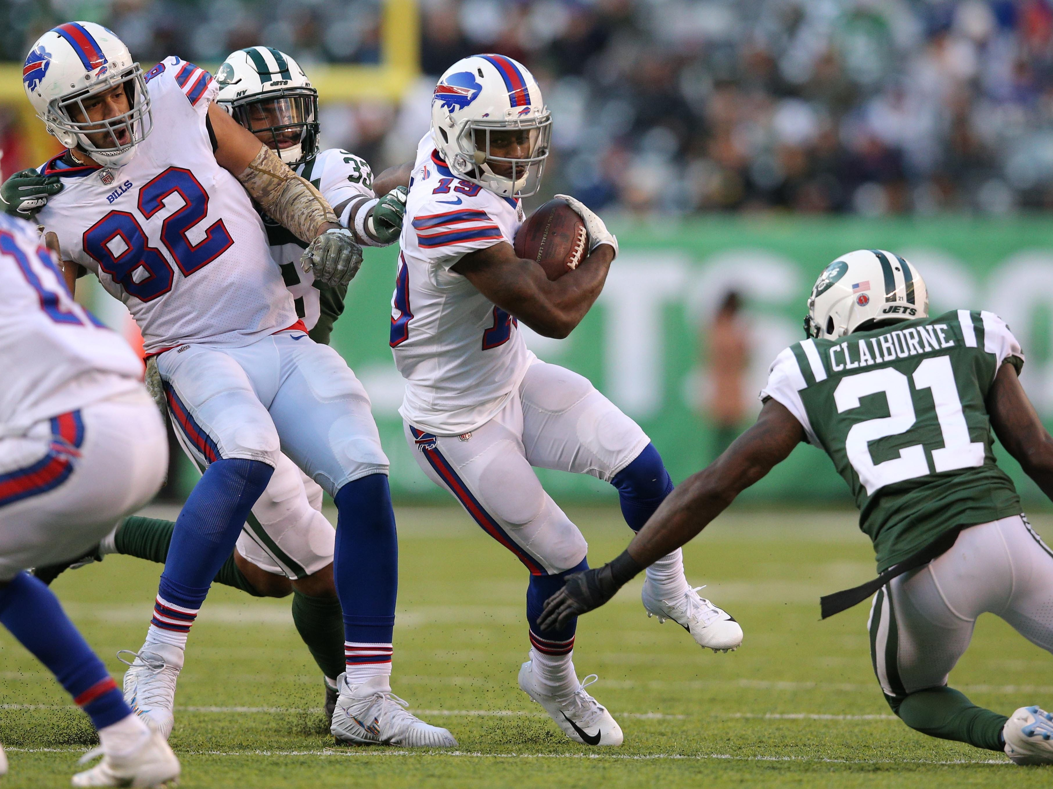 Nov 11, 2018; East Rutherford, NJ, USA; Buffalo Bills wide receiver Isaiah McKenzie (19) runs with the ball against New York Jets safety Jamal Adams (33) and New York Jets cornerback Morris Claiborne (21) during the fourth quarter at MetLife Stadium. Mandatory Credit: Brad Penner-USA TODAY Sports
