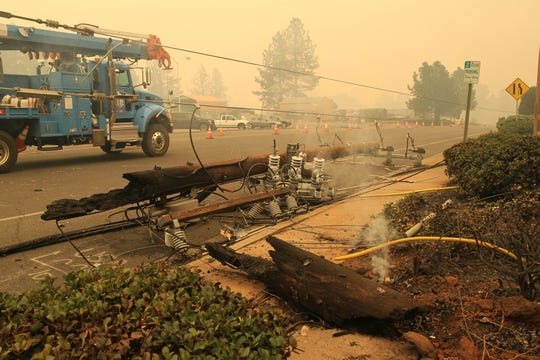 The Northern California town of Paradise was a burned ghost town on Friday, Nov. 9, 2018, a day after the Camp Fire swept through. Most of the businesses on the Skyway were destroyed. Some schools were burned out. People escaping the fire abandoned their cars on the road. This is Clark Road. (Hung T. Vu/Special to the Record Searchlight)
