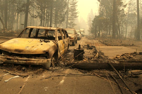 The Northern California town of Paradise was a burned ghost town on Friday, Nov. 9, 2018, a day after the Camp Fire swept through. Most of the businesses on the Skyway were destroyed. Some schools were burned out. People escaping the fire abandoned their cars on the road. (Hung T. Vu/Special to the Record Searchlight)