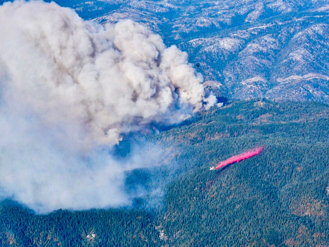 An air tanker drops retardant on the Camp Fire near Paradise on Sunday, Nov. 11, 2018.