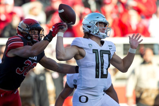 Nov 10, 2018; Salt Lake City, UT, USA; Utah Utes linebacker Cody Barton (30) knocks the ball out of the hand of Oregon Ducks quarterback Justin Herbert (10) for a fumble during the first quarter at Rice-Eccles Stadium. Mandatory Credit: Russ Isabella-USA TODAY Sports