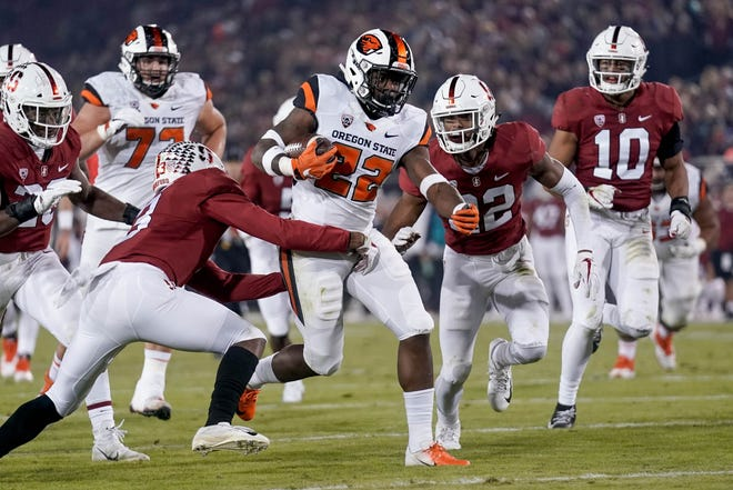 Nov 10, 2018; Stanford, CA, USA; Oregon State Beavers running back Jermar Jefferson (22) runs with the ball against Stanford Cardinal safety Malik Antoine (3) and cornerback Obi Eboh (22) during the second quarter at Stanford Stadium. Mandatory Credit: Stan Szeto-USA TODAY Sports