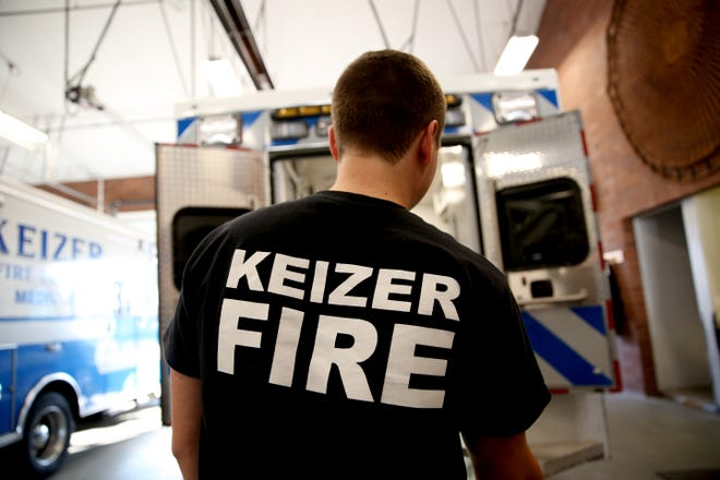 A Keizer Fire District firefighter preps a truck on Tuesday, Nov. 8, 2018, in Keizer. Citizens voted to renew the operational tax levy this year which provides the department with funding.
