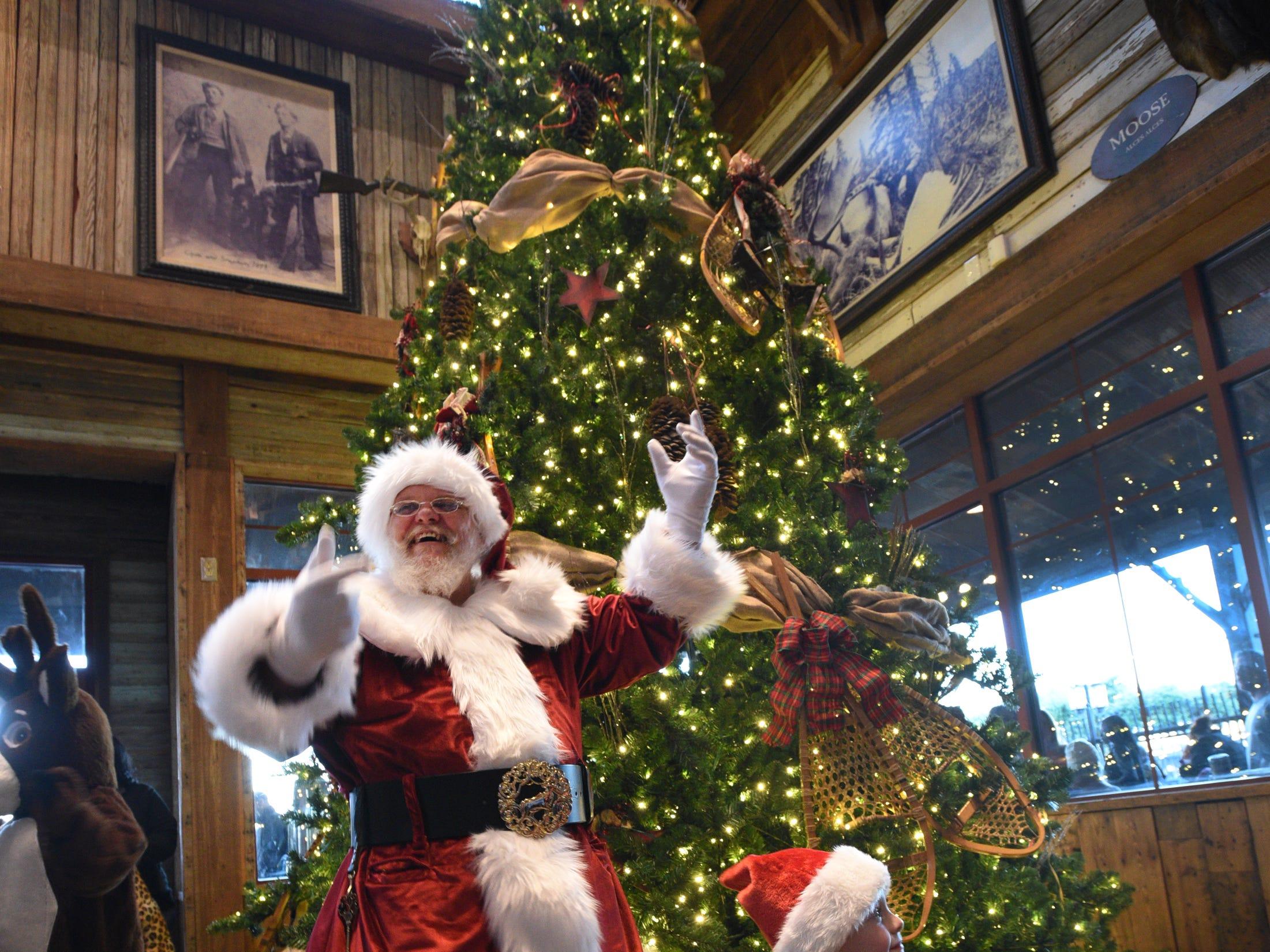 Santa lights the Christmas tree after the Bass Pro Shops-Louisiana Boardwalk Outlets Santa Parade.