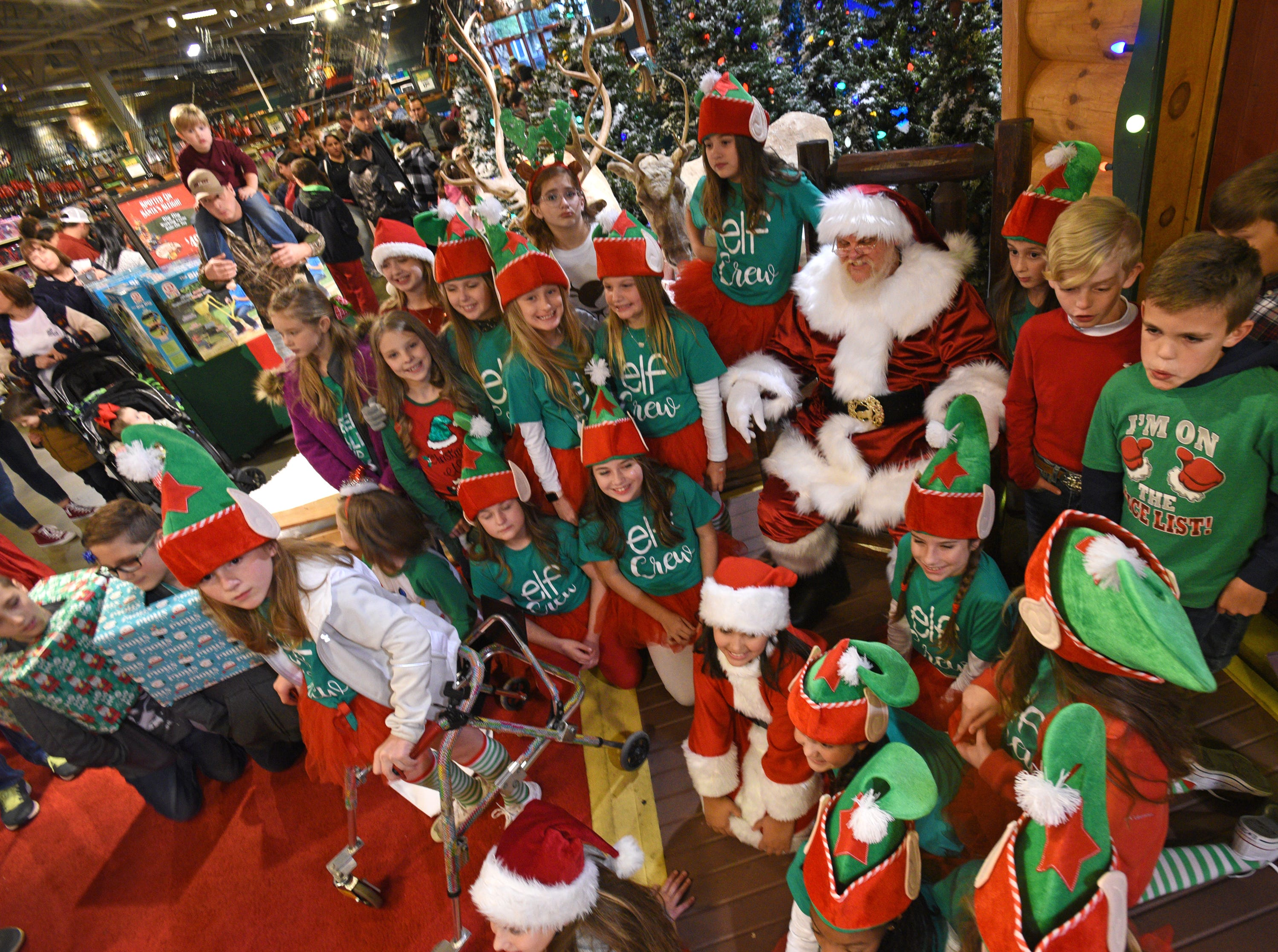 Santa poses for photos with good boys and girls in Wonderland after the Bass Pro Shops-Louisiana Boardwalk Outlets Santa Parade.