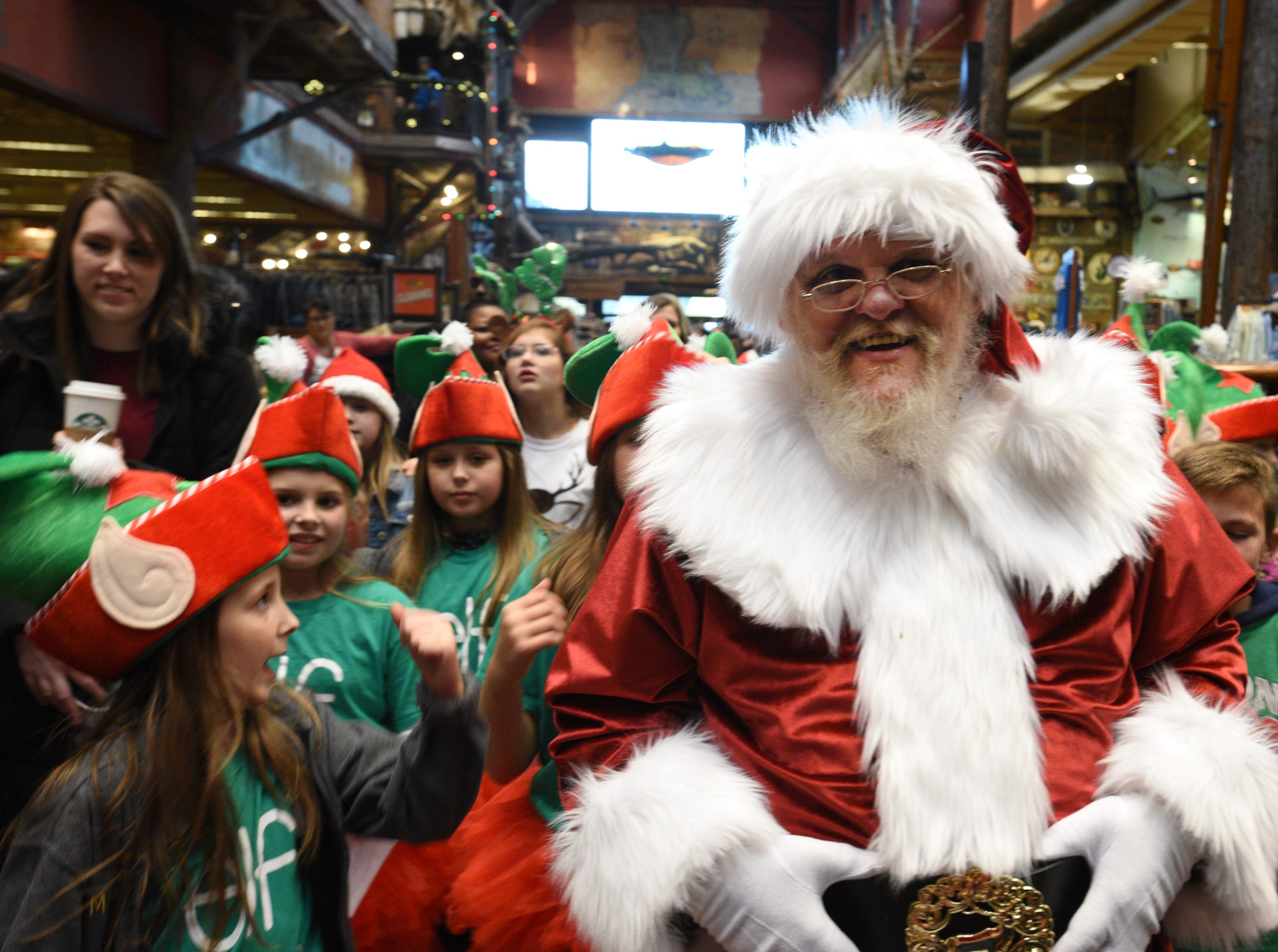 Santa leads his elfs to his Wonderland after the Bass Pro Shops-Louisiana Boardwalk Outlets Santa Parade.