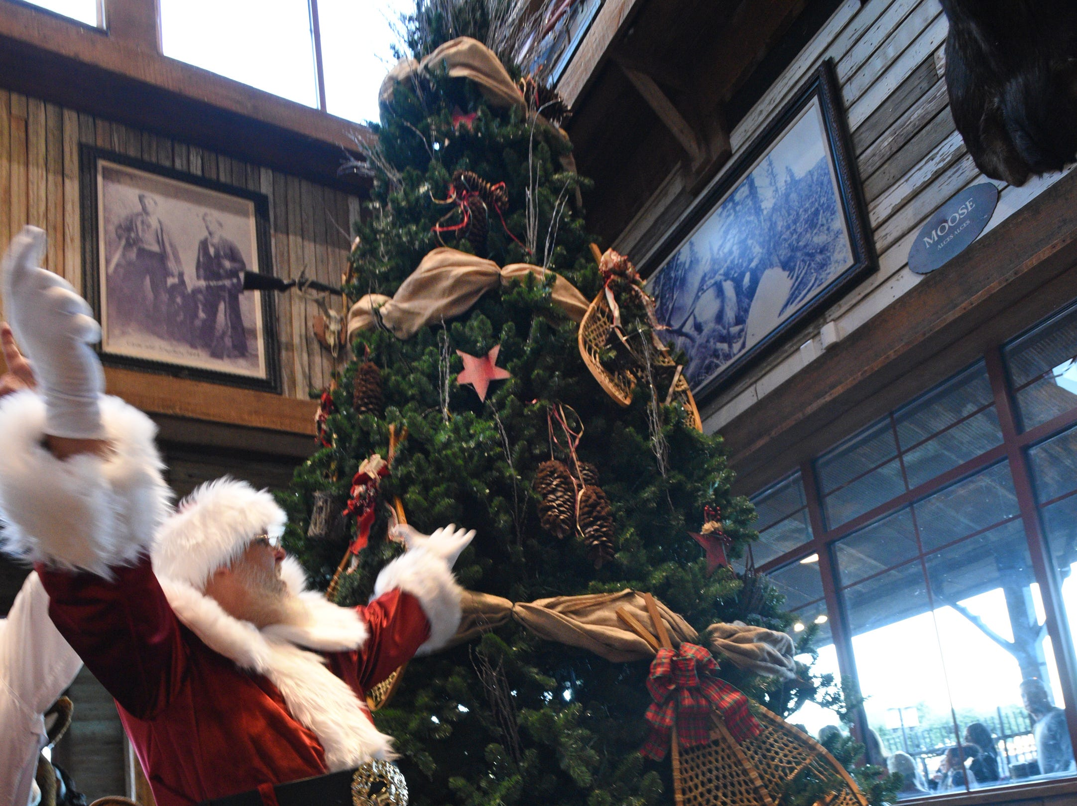 Santa prepares to light the Christmas tree after the Bass Pro Shops-Louisiana Boardwalk Outlets Santa Parade.
