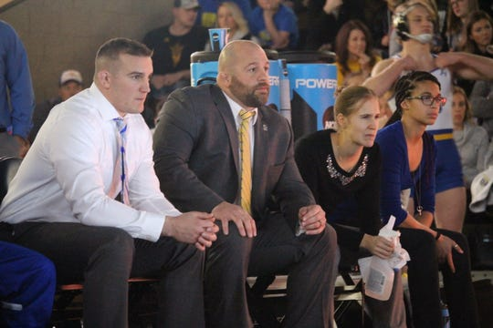 SDSU wrestling coach Damion Hahn (center) watches the action Sunday at the Sanford Pentagon
