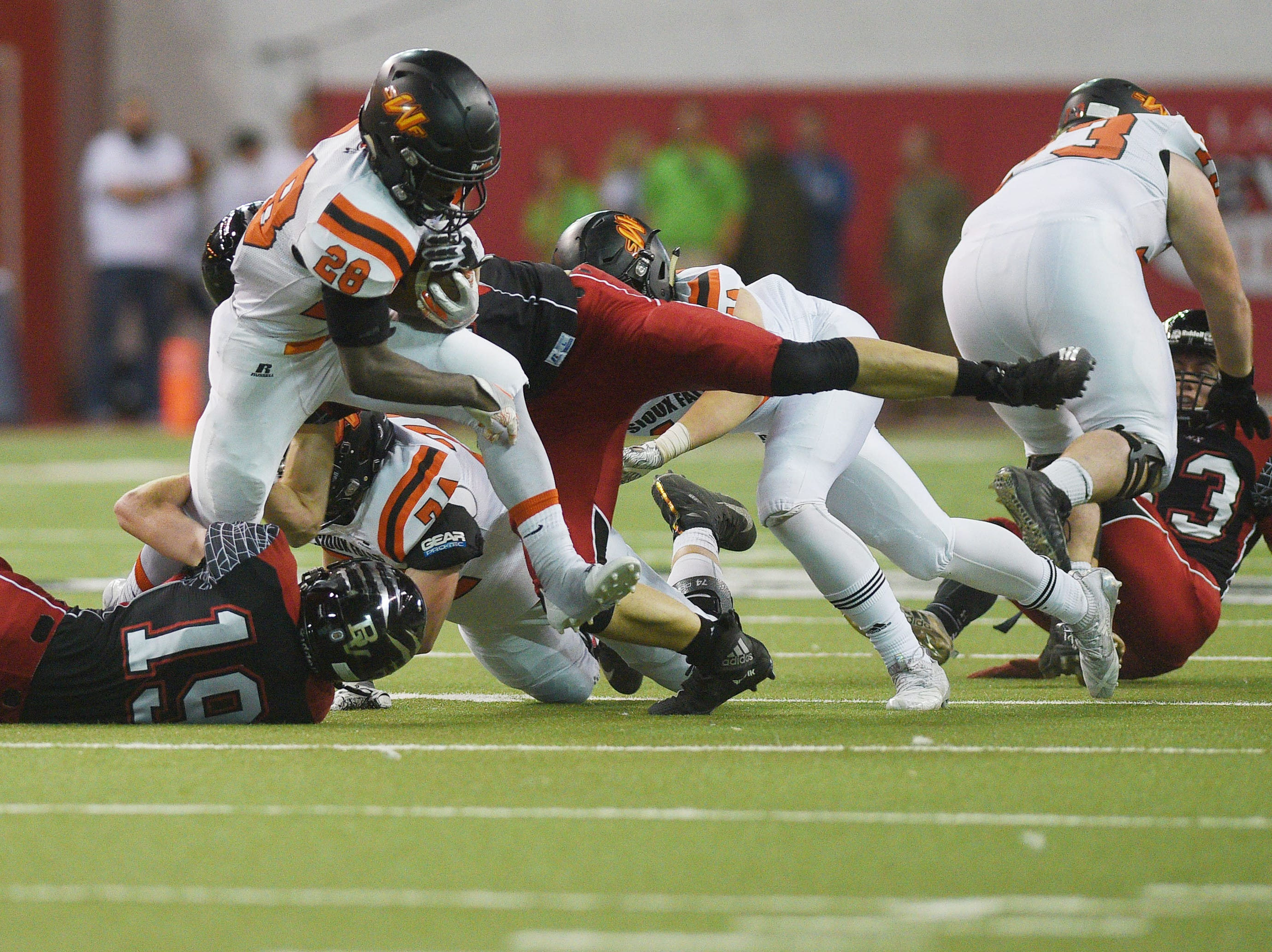 Washington's Tupak Kpeayeh goes against Brandon Valley defense during the game Saturday, Nov. 10, at the DakotaDome in Vermillion.
