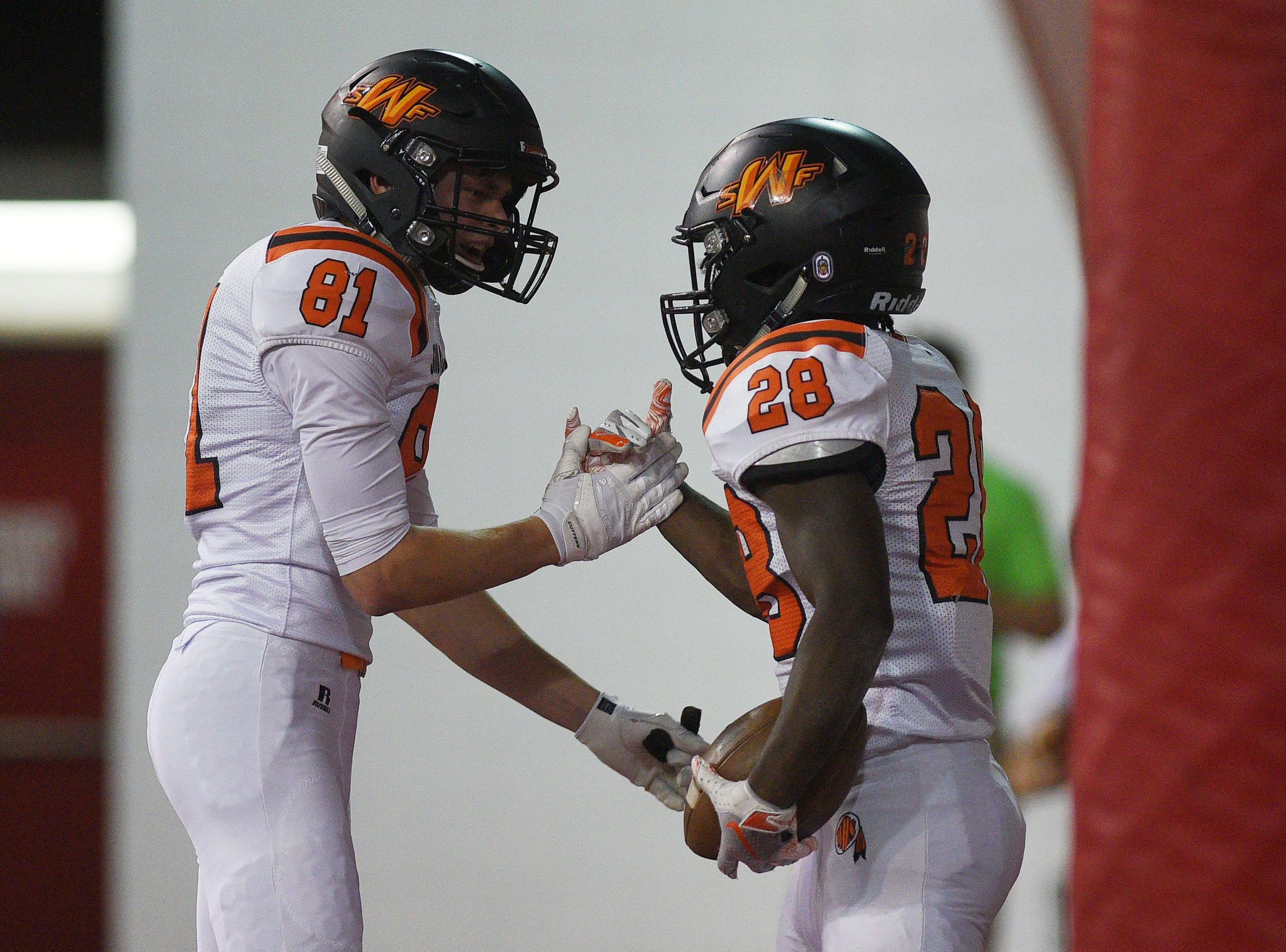Washington's Gabe Person (81) and Tupak Kpeayeh (28) celebrate in the end zone during the game against Brandon Valley  Saturday, Nov. 10, at the DakotaDome in Vermillion.