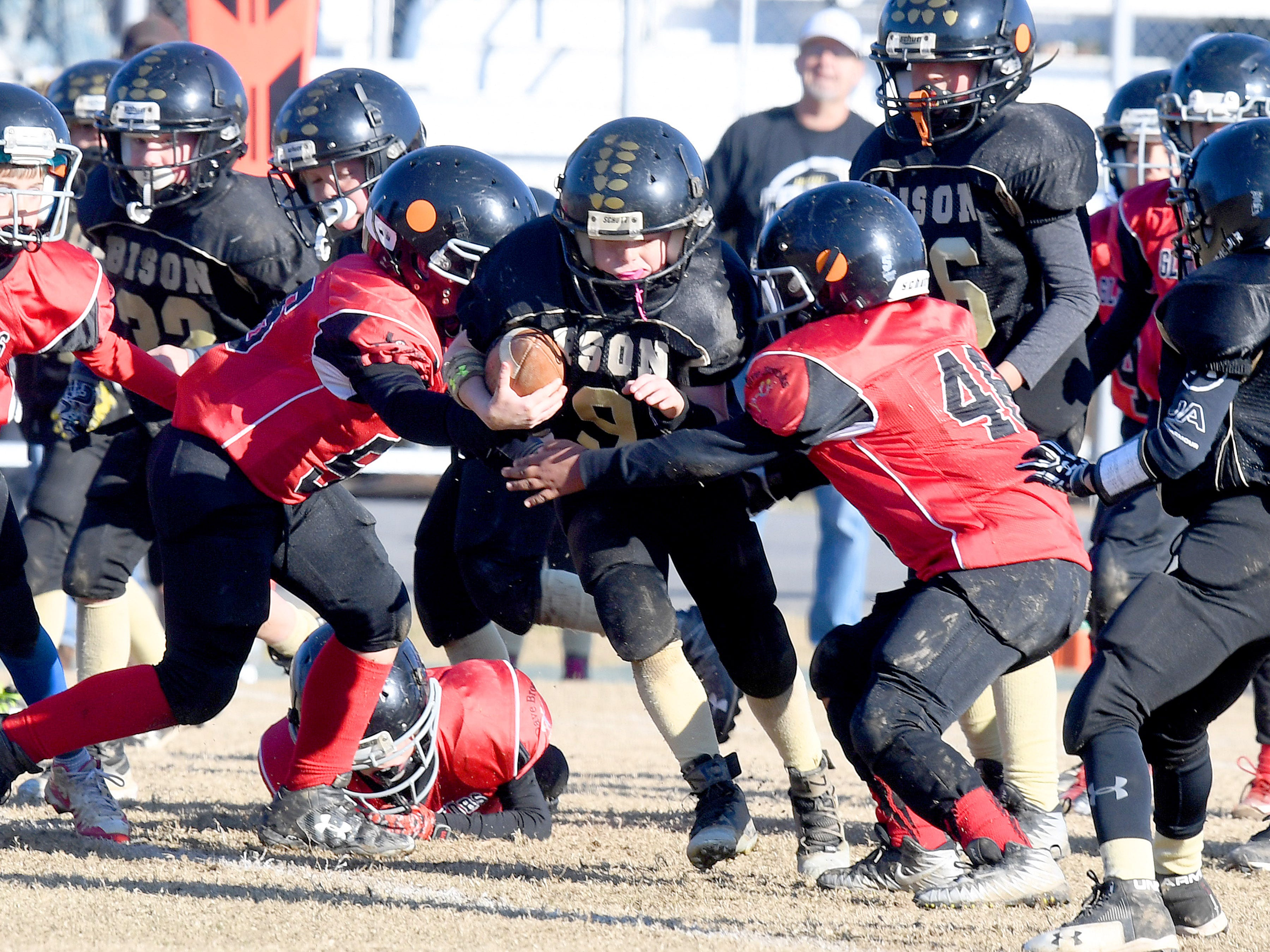 Buffalo Gap's Brandon Argenbright tries to break through the line with the ball during the Augusta County Quarterback Club Midget Super Bowl in Fishersville on Sunday, Nov. 11, 2018. Riverheads beat Buffalo Gap, 25-6.
