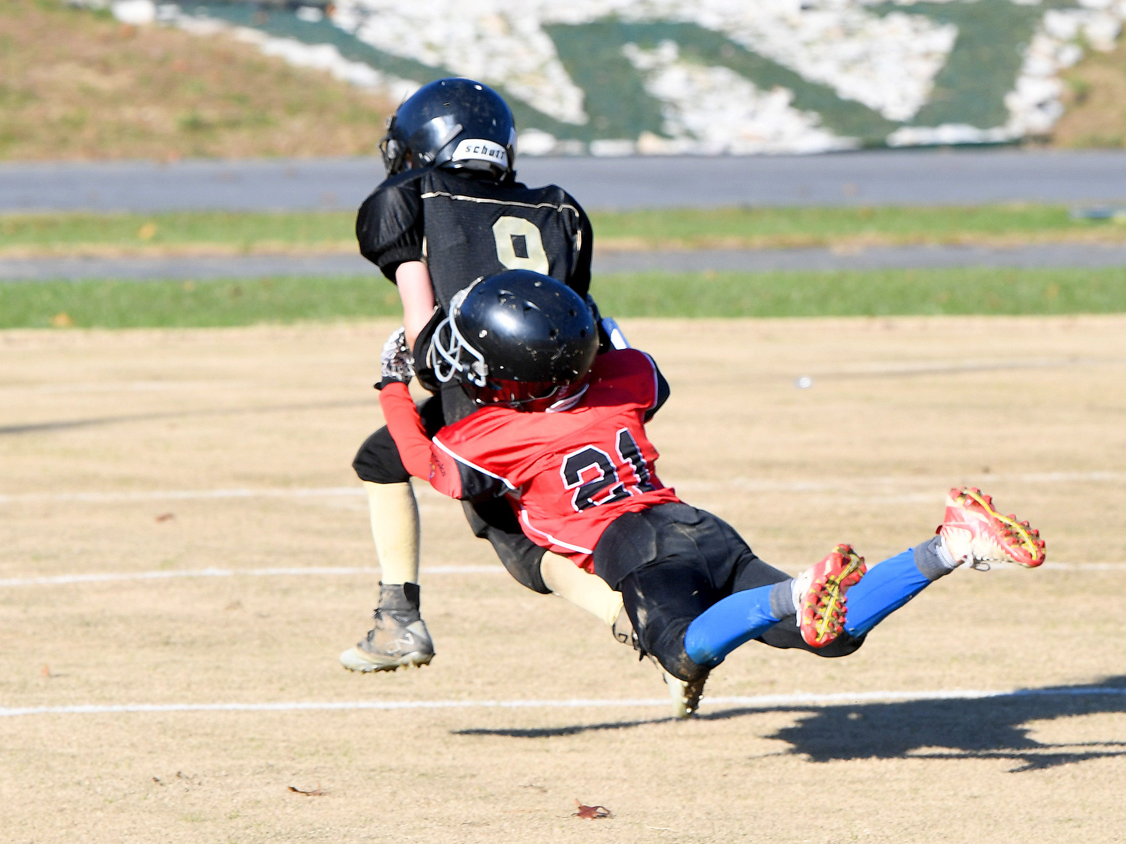 Riverheads' Bryson Cash leaps forward to grab onto Buffalo Gap ball carrier Brandon Argenbright to bring him down during the Augusta County Quarterback Club Midget Super Bowl in Fishersville on Sunday, Nov. 11, 2018. Riverheads beat Buffalo Gap, 25-6.