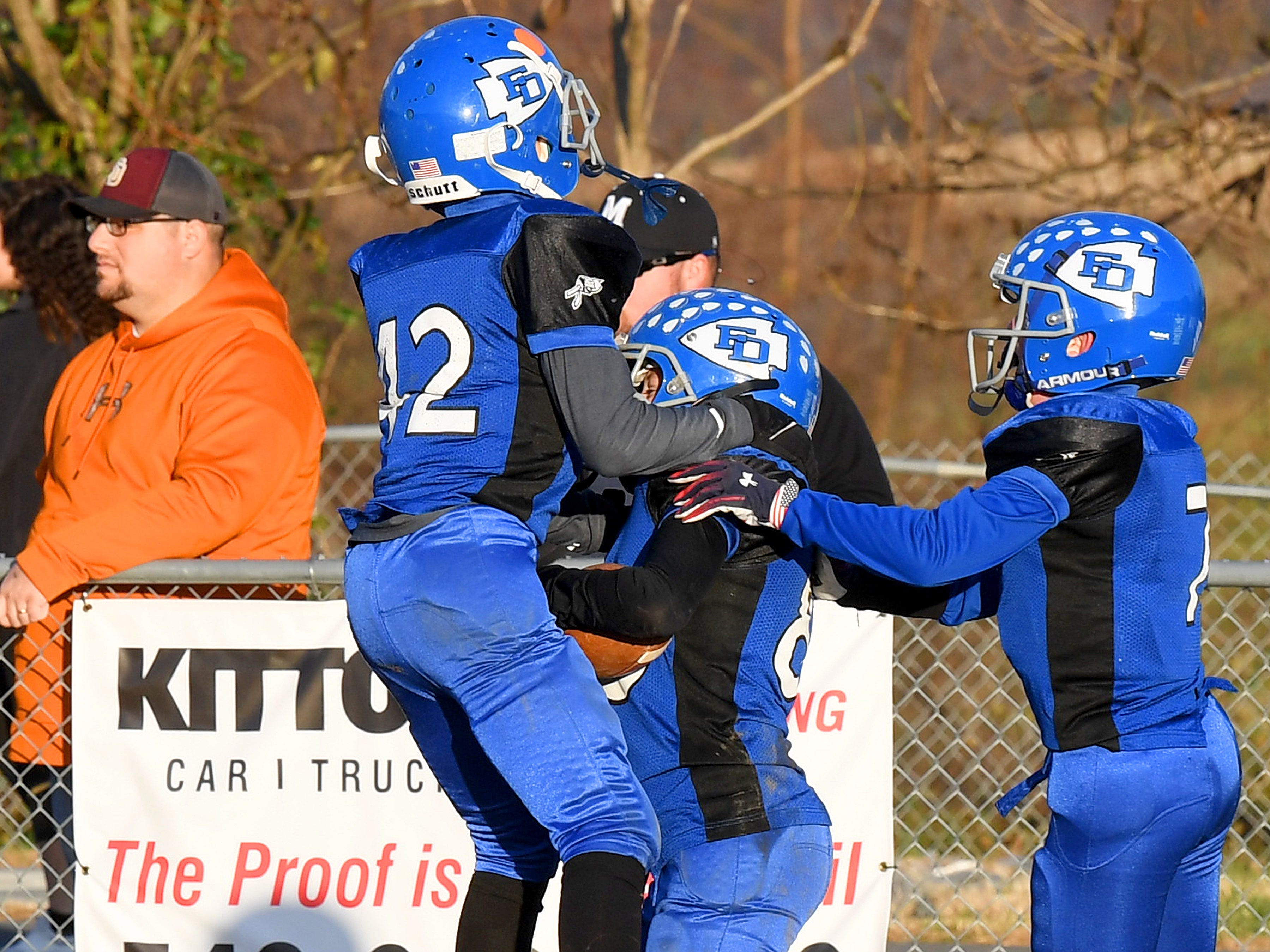 Fort Defiance players celebrate a touchdown during the Augusta County Quarterback Club Juniors Super Bowl in Fishersville on Sunday, Nov. 11, 2018.  Fort Defiance beats Stuarts Draft, 13-12.