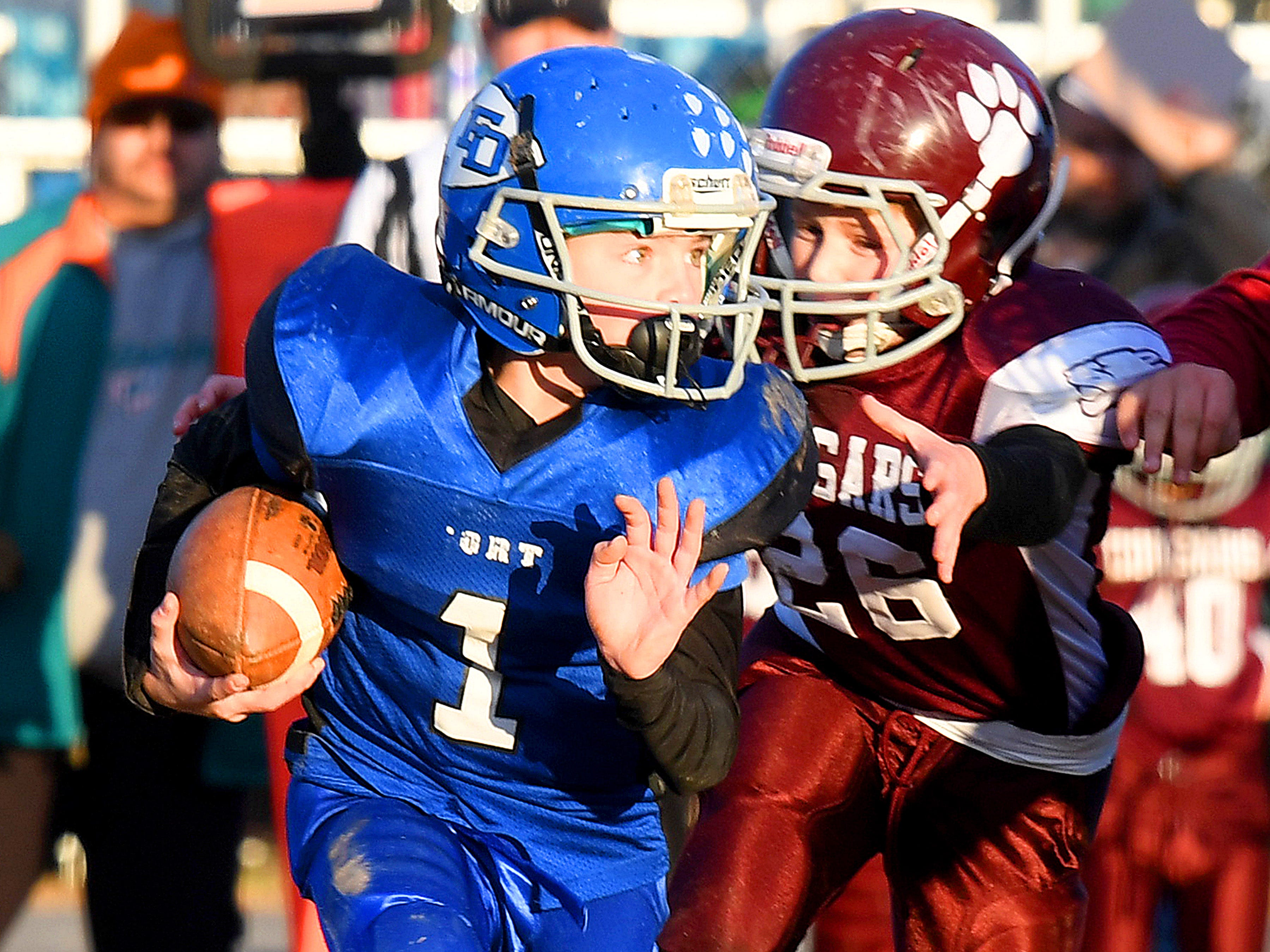 Fort Defiance's Bradley Hebb runs the football as Stuarts Draft's Ryan Ramsey goes for a tackle during the Augusta County Quarterback Club Juniors Super Bowl in Fishersville on Sunday, Nov. 11, 2018.  Fort Defiance beats Stuarts Draft, 13-12.