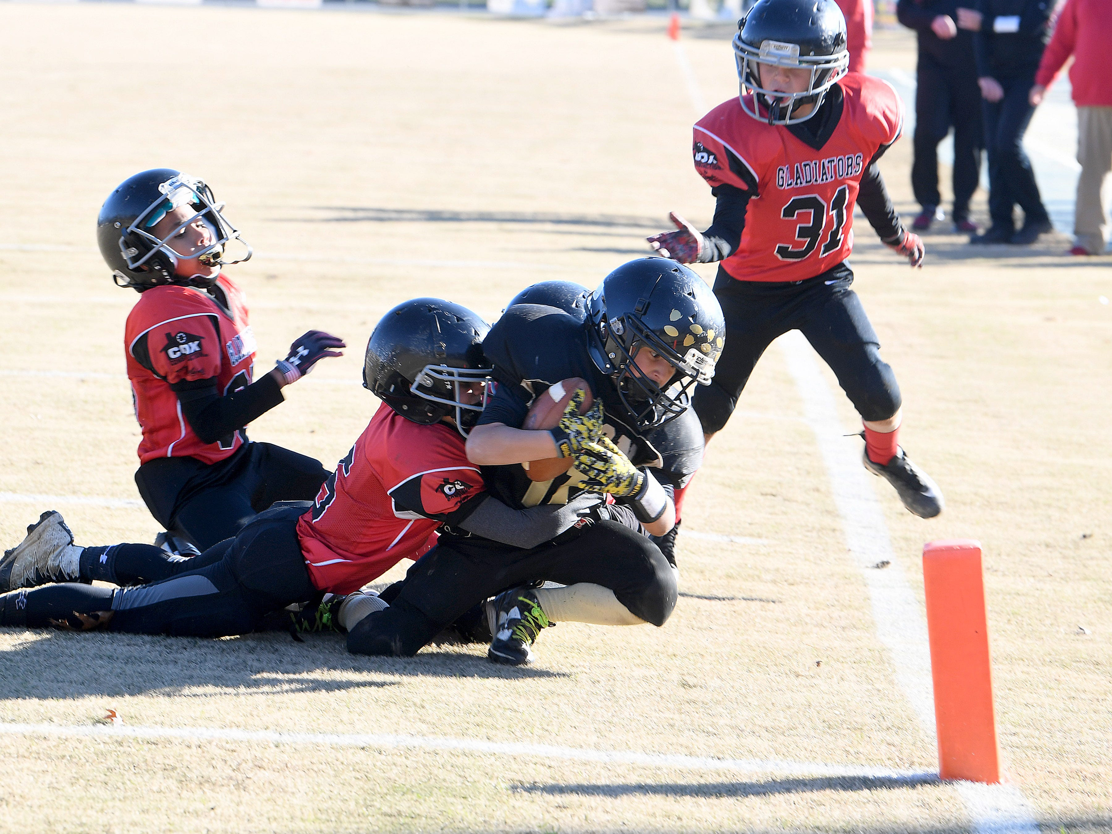 Buffalo Gap's Peyton Loan is wrapped up and brought down by the Riverheads' defense just short of the end zone  during the Augusta County Quarterback Club Midget Super Bowl in Fishersville on Sunday, Nov. 11, 2018. Riverheads beat Buffalo Gap, 25-6.