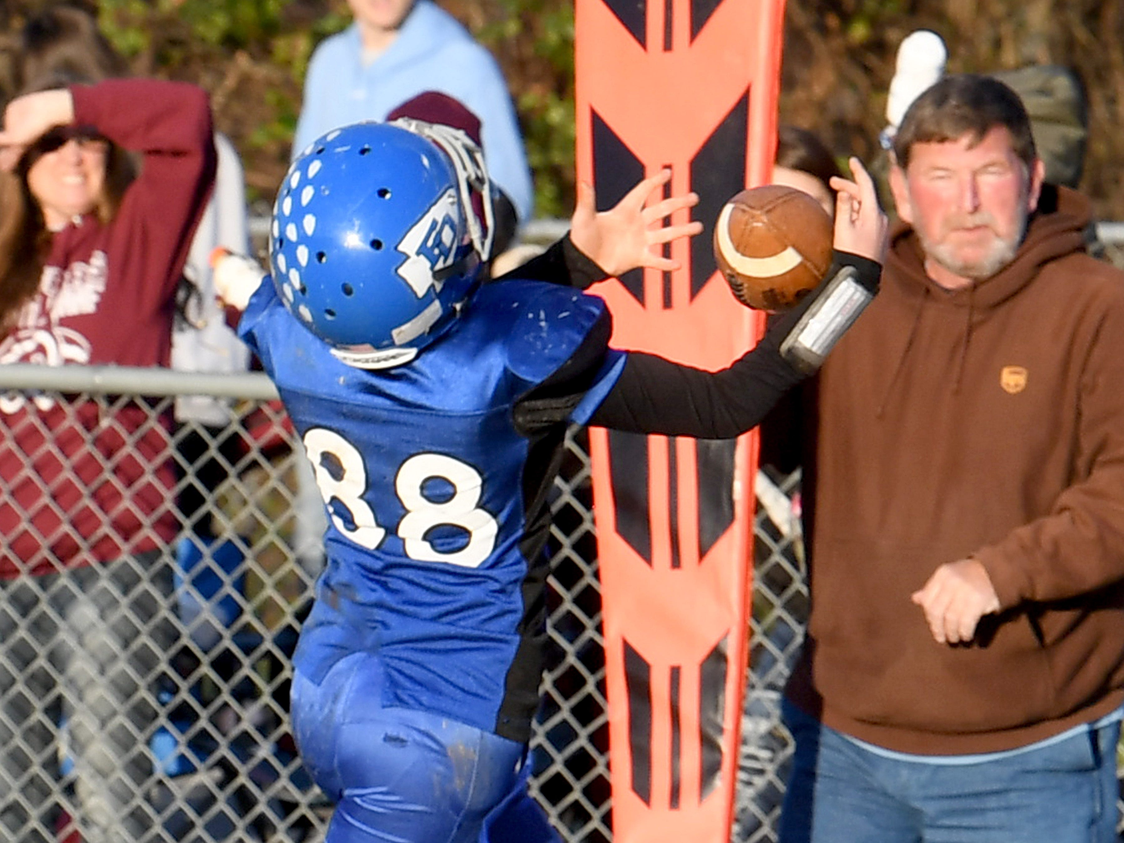 Fort Defiance's Carter Berry catches the ball for a pass completion and will run it downfield into the end zone for a touchdown during the Augusta County Quarterback Club Juniors Super Bowl in Fishersville on Sunday, Nov. 11, 2018.  Fort Defiance beats Stuarts Draft, 13-12.