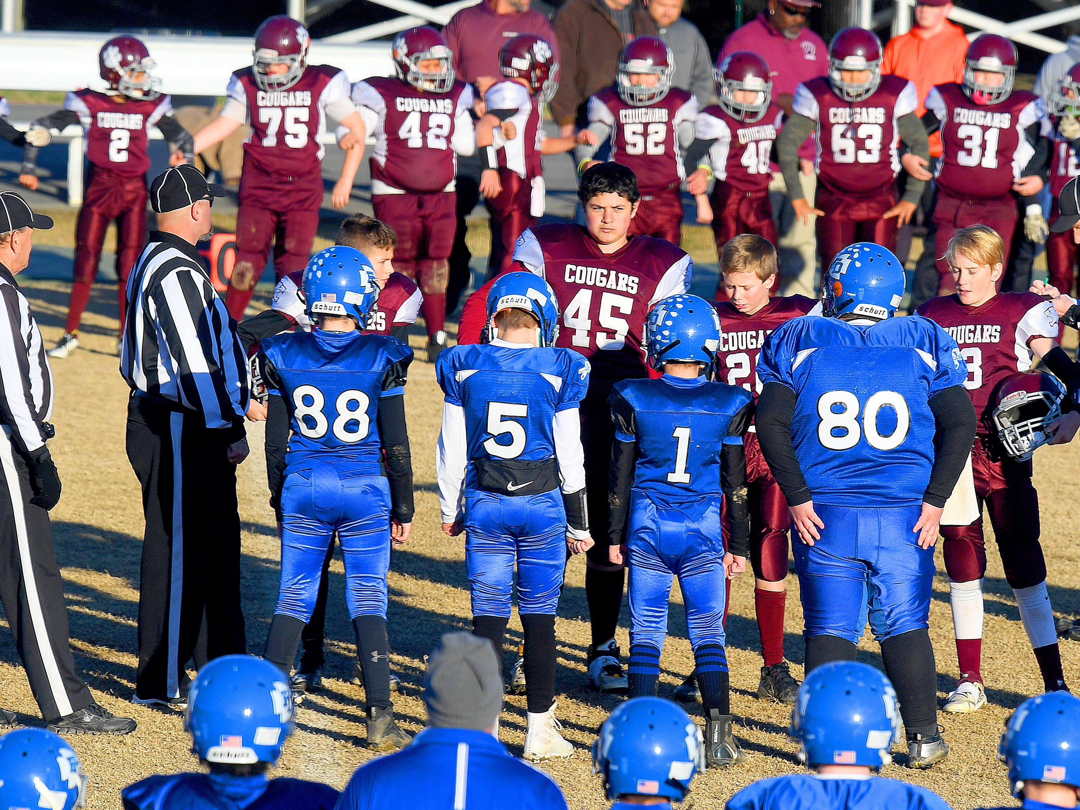 Team captains meet center of the field for Stuarts Draft and Fort Defiance for the coin toss ceremony during the Augusta County Quarterback Club Juniors Super Bowl in Fishersville on Sunday, Nov. 11, 2018. Fort Defiance beats Stuarts Draft, 13-12.