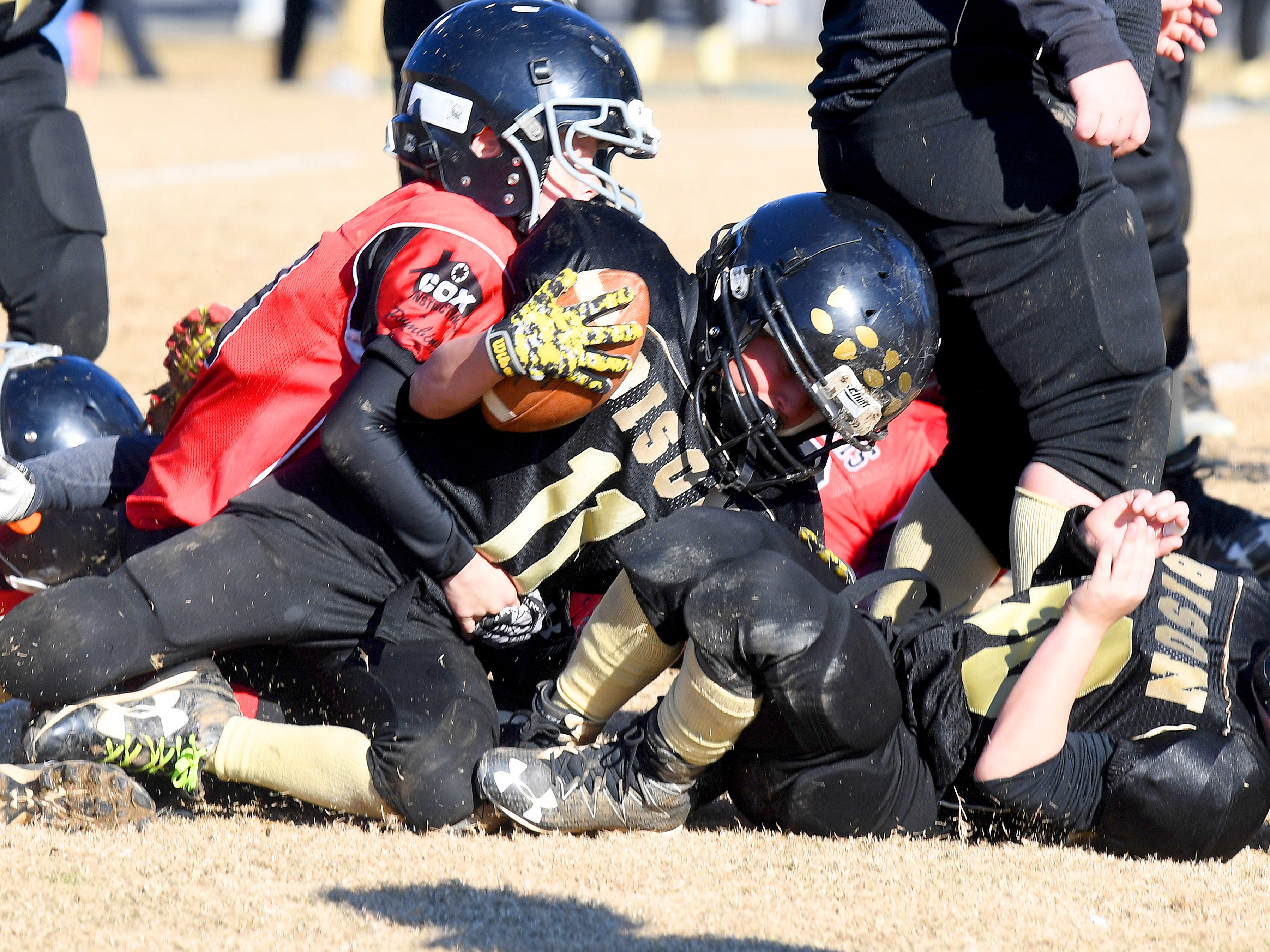 Buffalo Gap's Peyton Loan is tackled with the football during the Augusta County Quarterback Club Midget Super Bowl in Fishersville on Sunday, Nov. 11, 2018. Riverheads beat Buffalo Gap, 25-6.