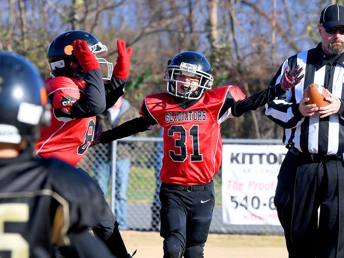 Riverheads' Eli Sorrells celebrates scoring a touchdown during the Augusta County Quarterback Club Midget Super Bowl in Fishersville on Sunday, Nov. 11, 2018. Riverheads beat Buffalo Gap, 25-6.