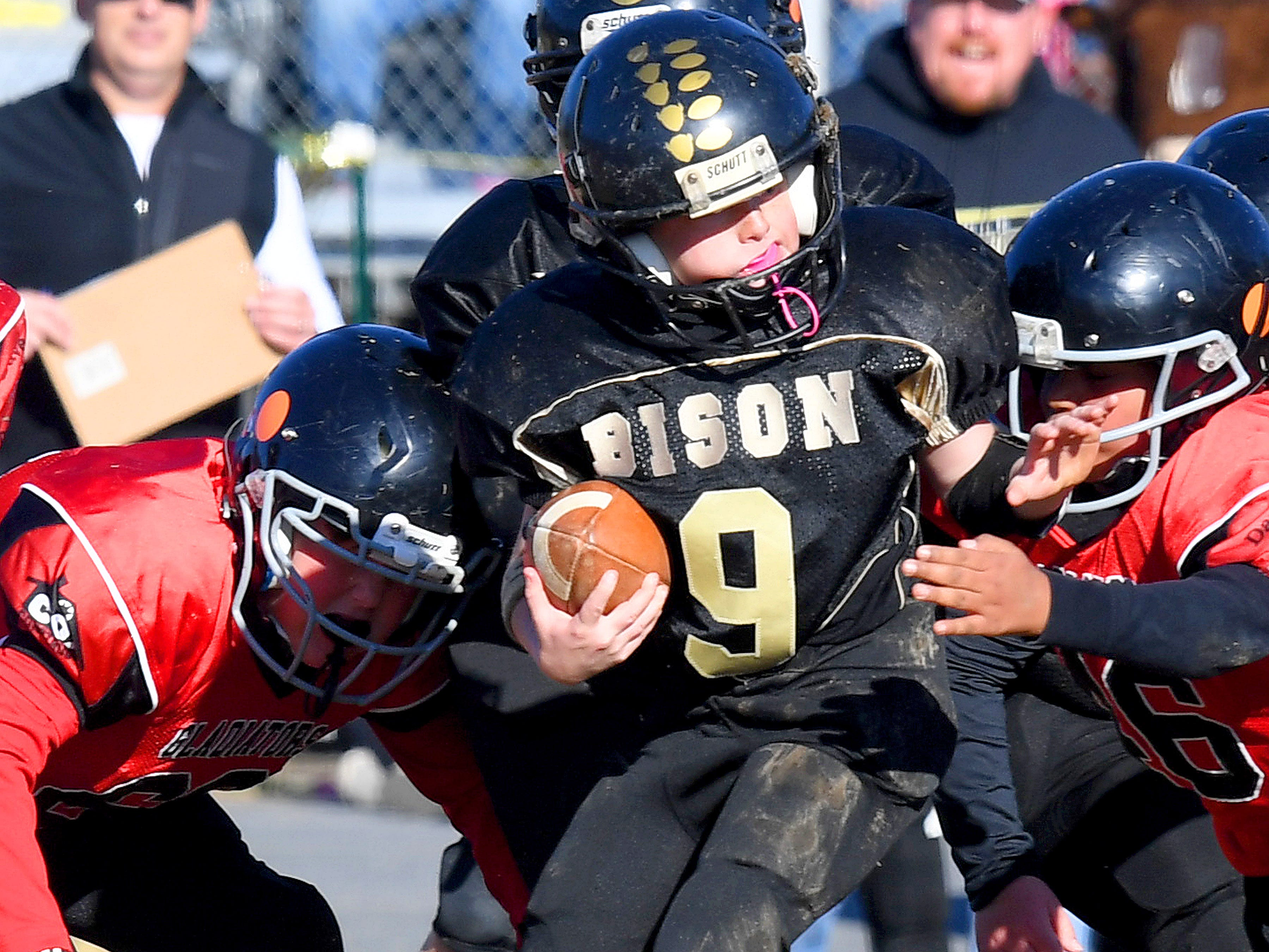 Buffalo Gap's Brandon Argenbright finds himself caught between two Riverheads' defenders as he has the ball during the Augusta County Quarterback Club Midget Super Bowl in Fishersville on Sunday, Nov. 11, 2018. Riverheads beat Buffalo Gap, 25-6.