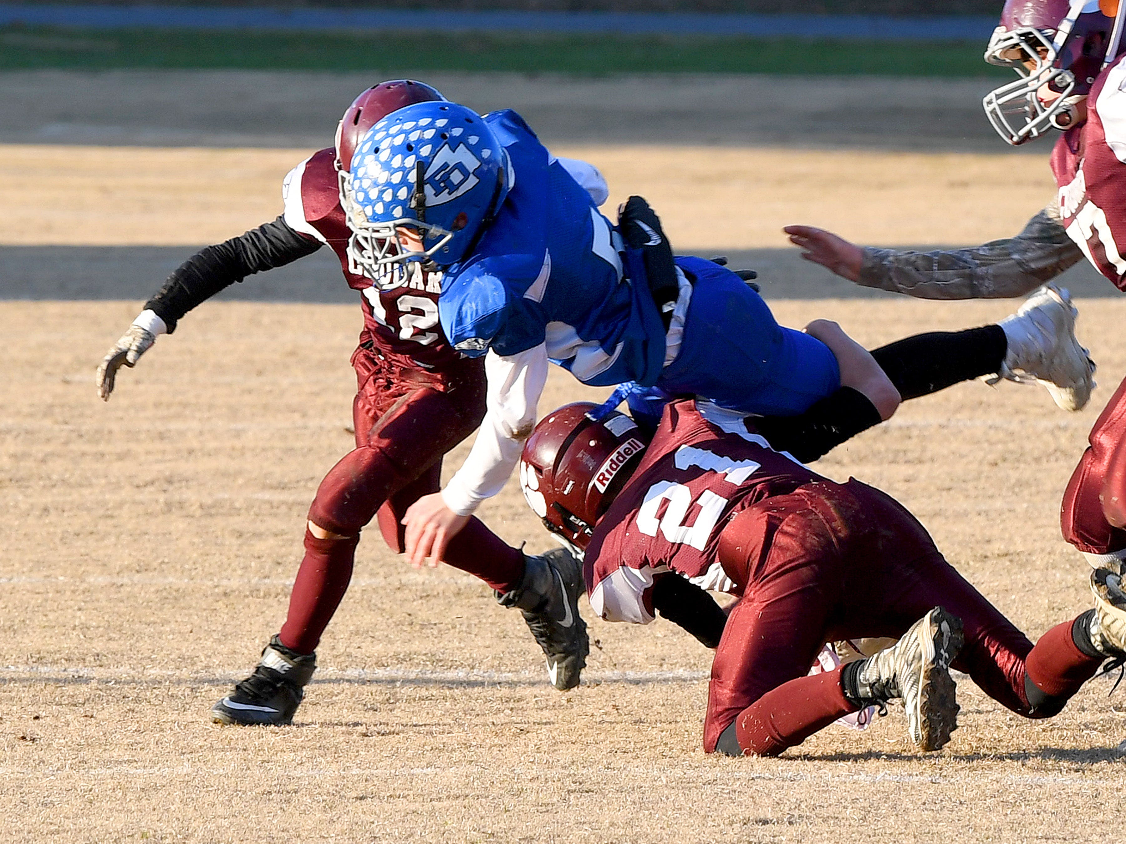 Fort Defiance's Trey Miller goes down with the ball as he is tackled by Stuarts Draft's Mason Sprouse and Landon Graber during the Augusta County Quarterback Club Juniors Super Bowl in Fishersville on Sunday, Nov. 11, 2018.  Fort Defiance beats Stuarts Draft, 13-12.