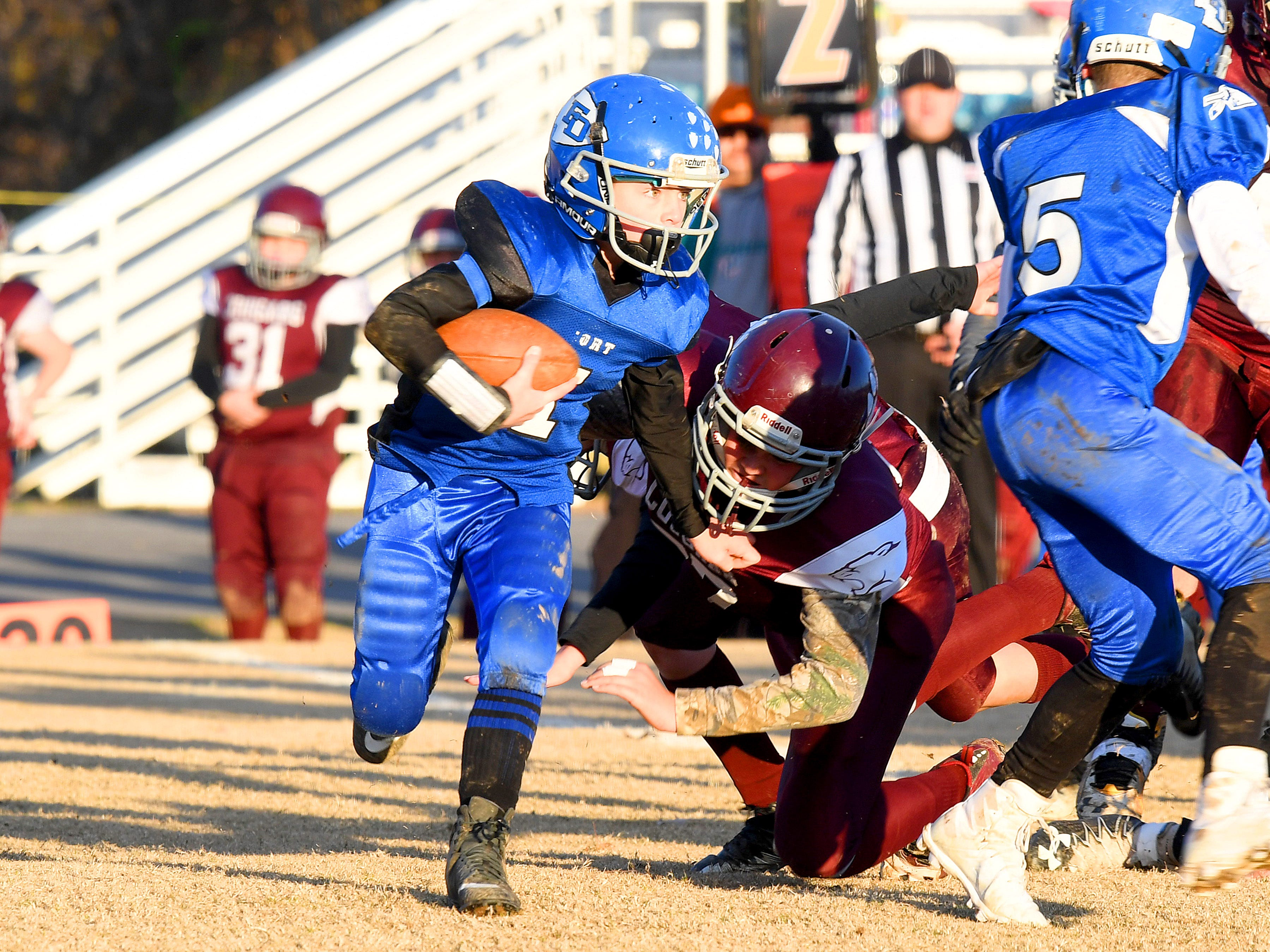 Fort Defiance's Bradley Hebb breaks free of a tackle attempt and keeps running the ball during the Augusta County Quarterback Club Juniors Super Bowl in Fishersville on Sunday, Nov. 11, 2018.  Fort Defiance beats Stuarts Draft, 13-12.
