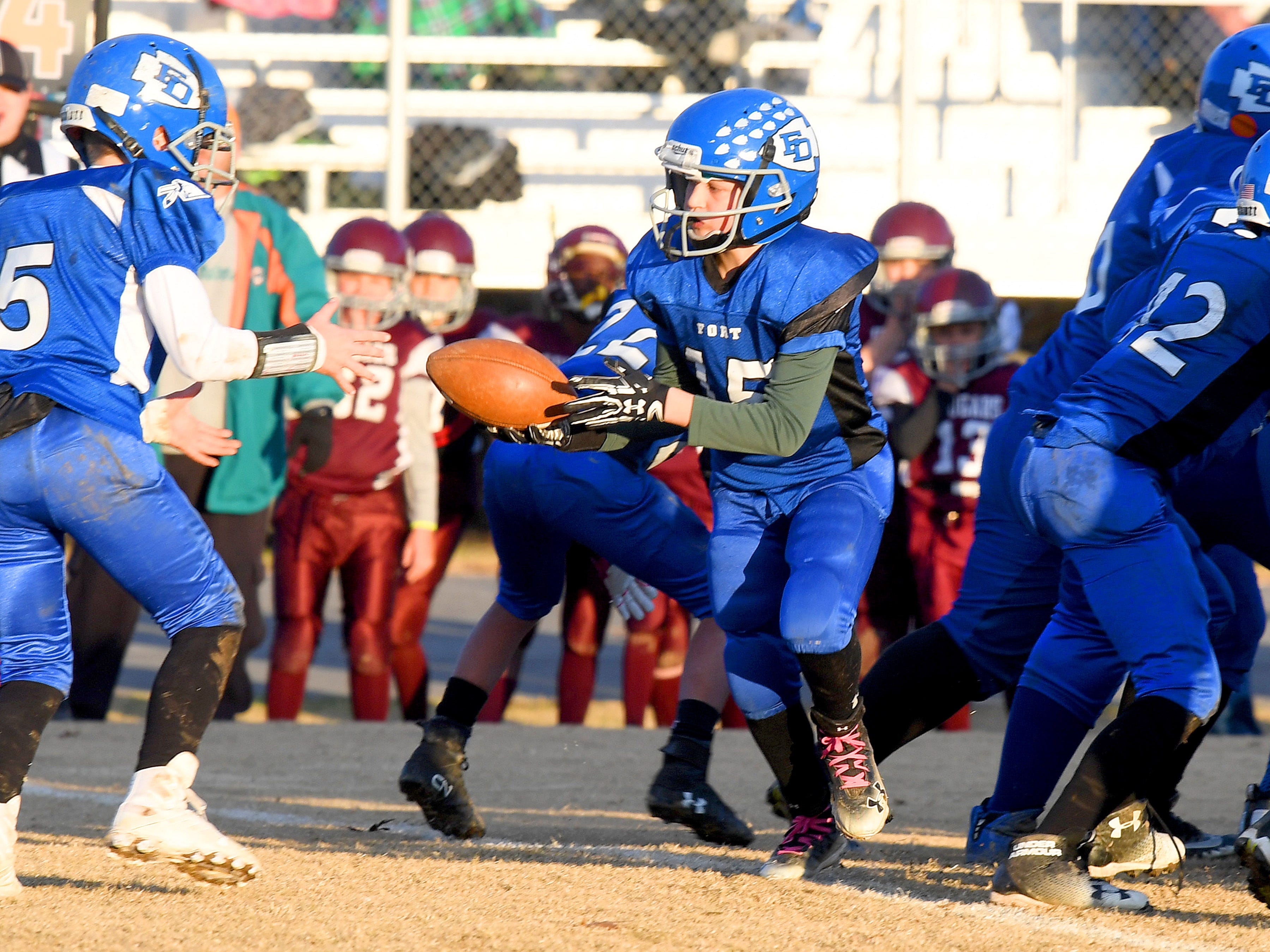 Fort Defiance'sLandyn Rose (center) hands off the football during the Augusta County Quarterback Club Juniors Super Bowl in Fishersville on Sunday, Nov. 11, 2018.  Fort Defiance beats Stuarts Draft, 13-12.