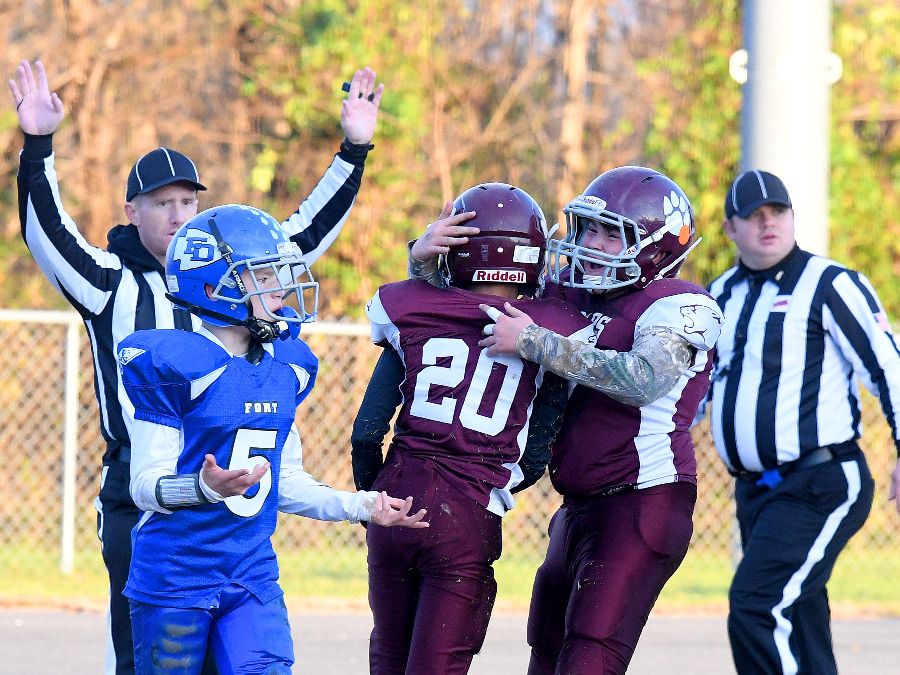 Stuarts Draft's Christopher Watkins (#20) is congratulated by a teammate after he caught the ball for a first down during the Augusta County Quarterback Club Juniors Super Bowl in Fishersville on Sunday, Nov. 11, 2018.  Fort Defiance beats Stuarts Draft, 13-12.