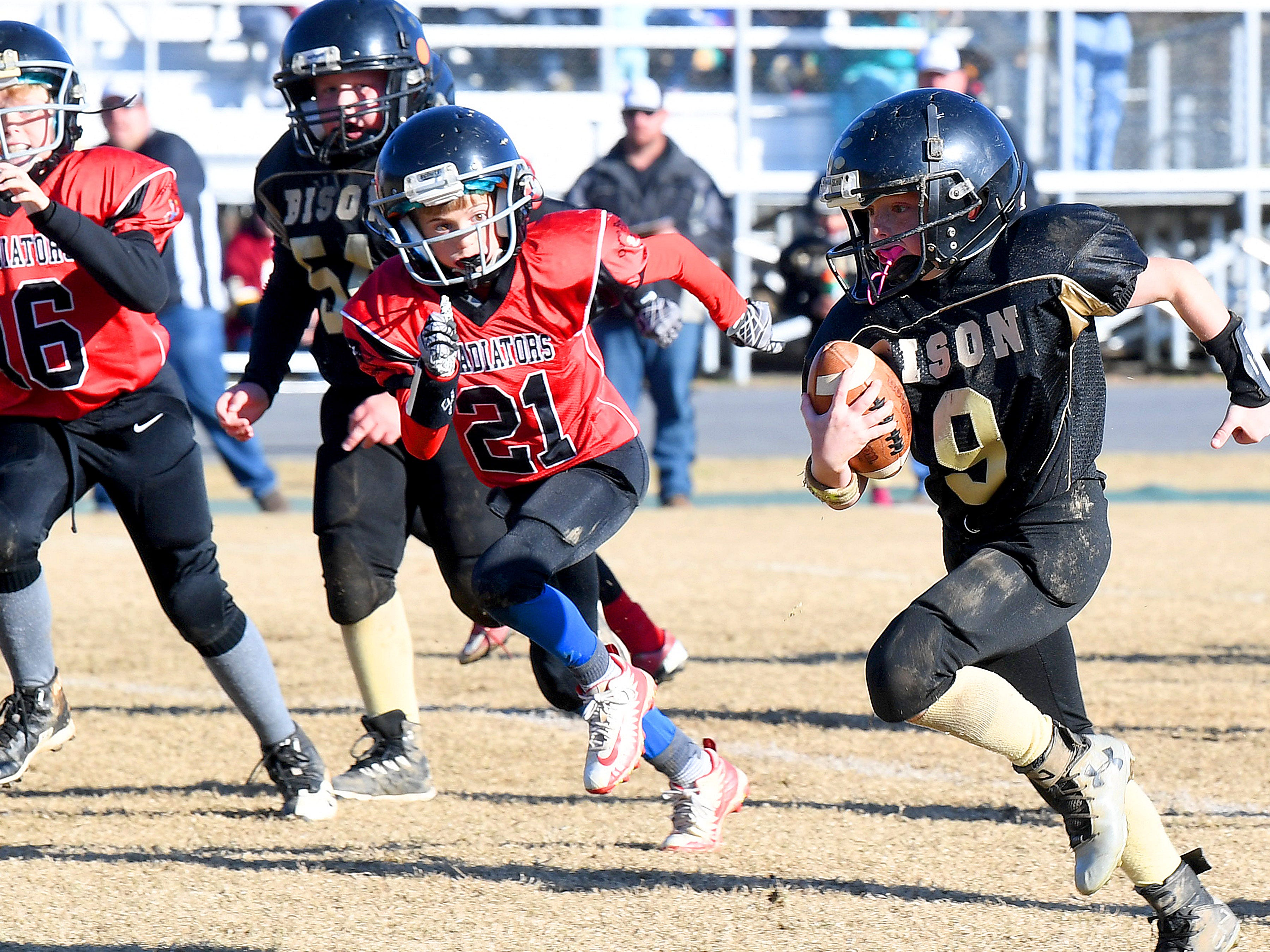 Riverheads' Bryson Cash closes in on Buffalo Gap ball carrier Brandon Argenbright during the Augusta County Quarterback Club Midget Super Bowl in Fishersville on Sunday, Nov. 11, 2018. Riverheads beat Buffalo Gap, 25-6.