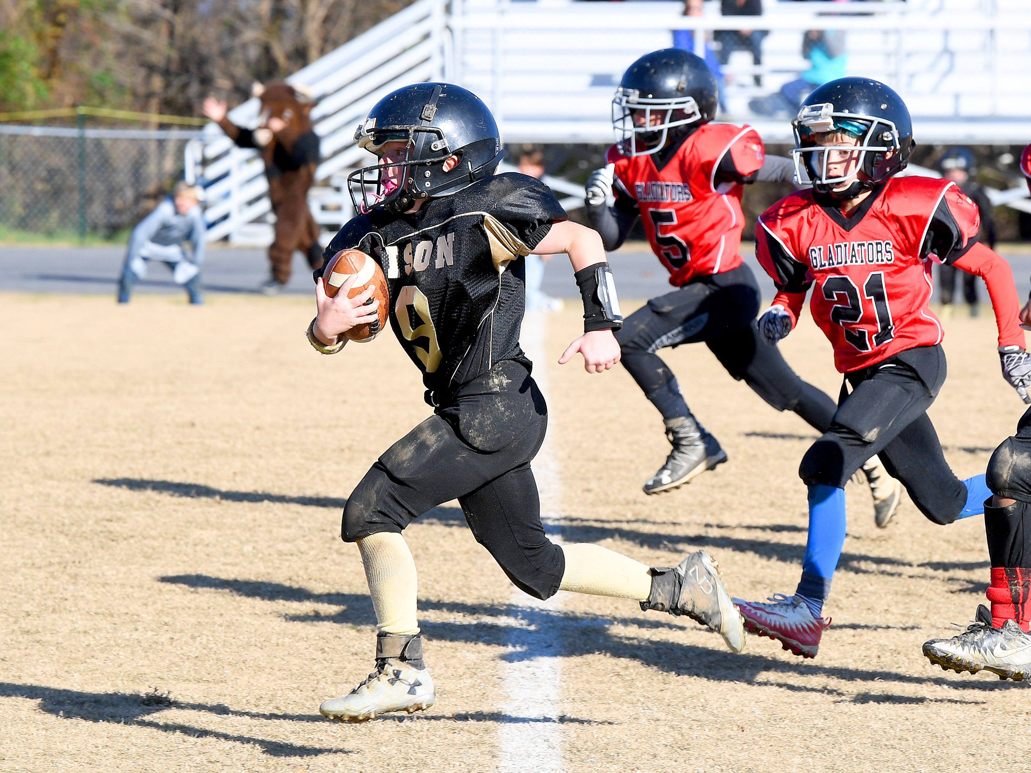 Buffalo Gap's Brandon Argenbright breaks away with the football and keeps going during the Augusta County Quarterback Club Midget Super Bowl in Fishersville on Sunday, Nov. 11, 2018. Riverheads beat Buffalo Gap, 25-6.