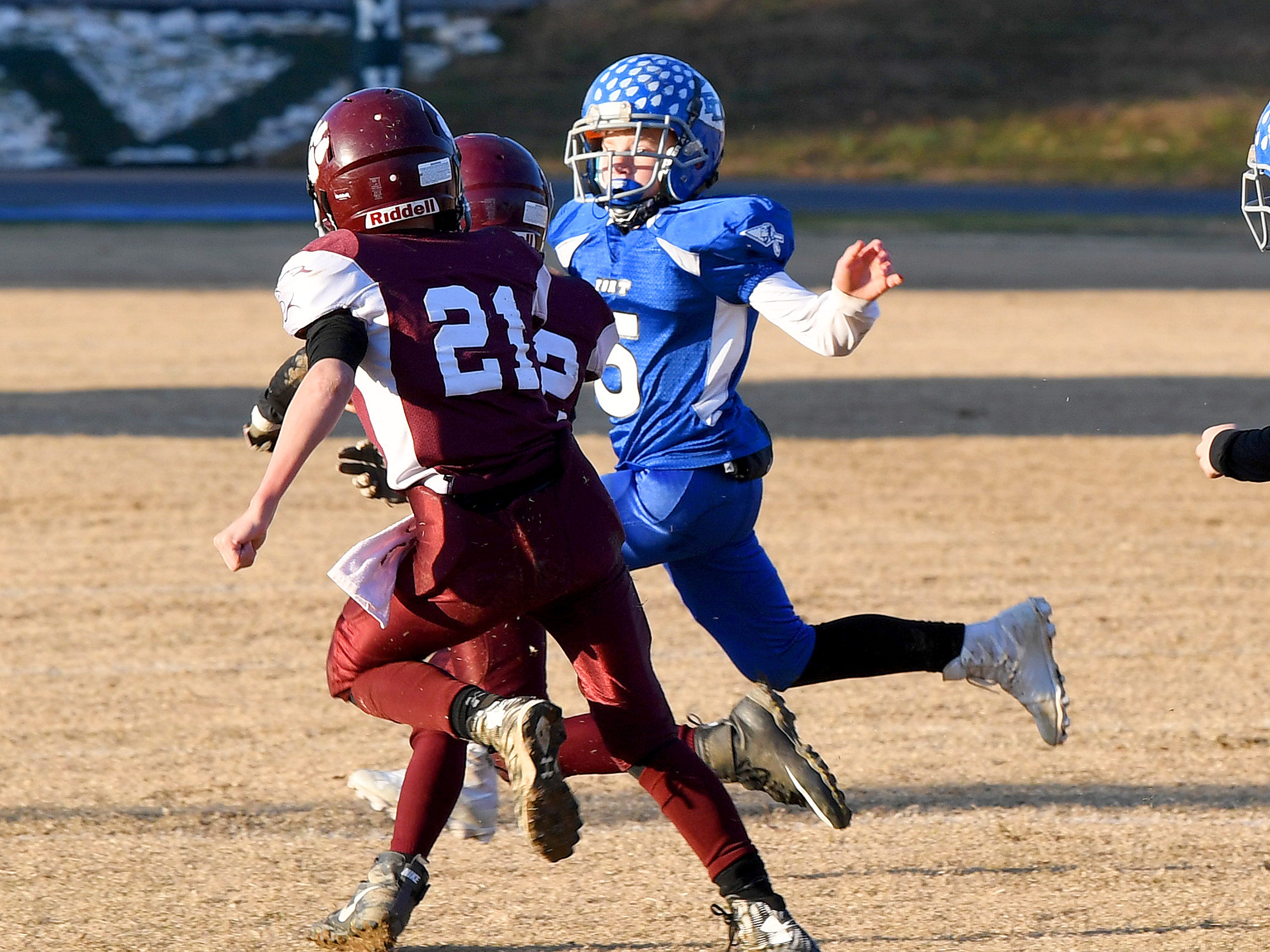 Fort Defiance's Trey Miller runs the ball to the side as Stuarts Draft's Landon Graber turns his way during the Augusta County Quarterback Club Juniors Super Bowl in Fishersville on Sunday, Nov. 11, 2018.  Fort Defiance beats Stuarts Draft, 13-12.