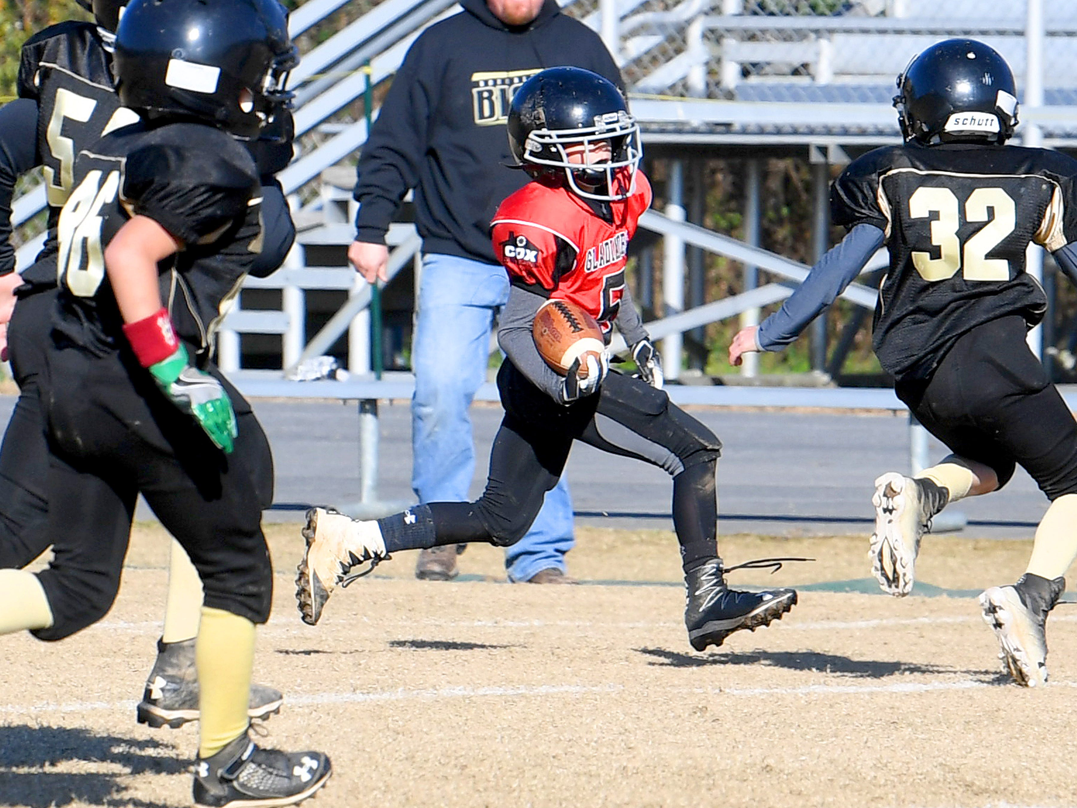Riverheads' Jackson Fitzgerald runs the football during the Augusta County Quarterback Club Midget Super Bowl in Fishersville on Sunday, Nov. 11, 2018. Riverheads beat Buffalo Gap, 25-6.