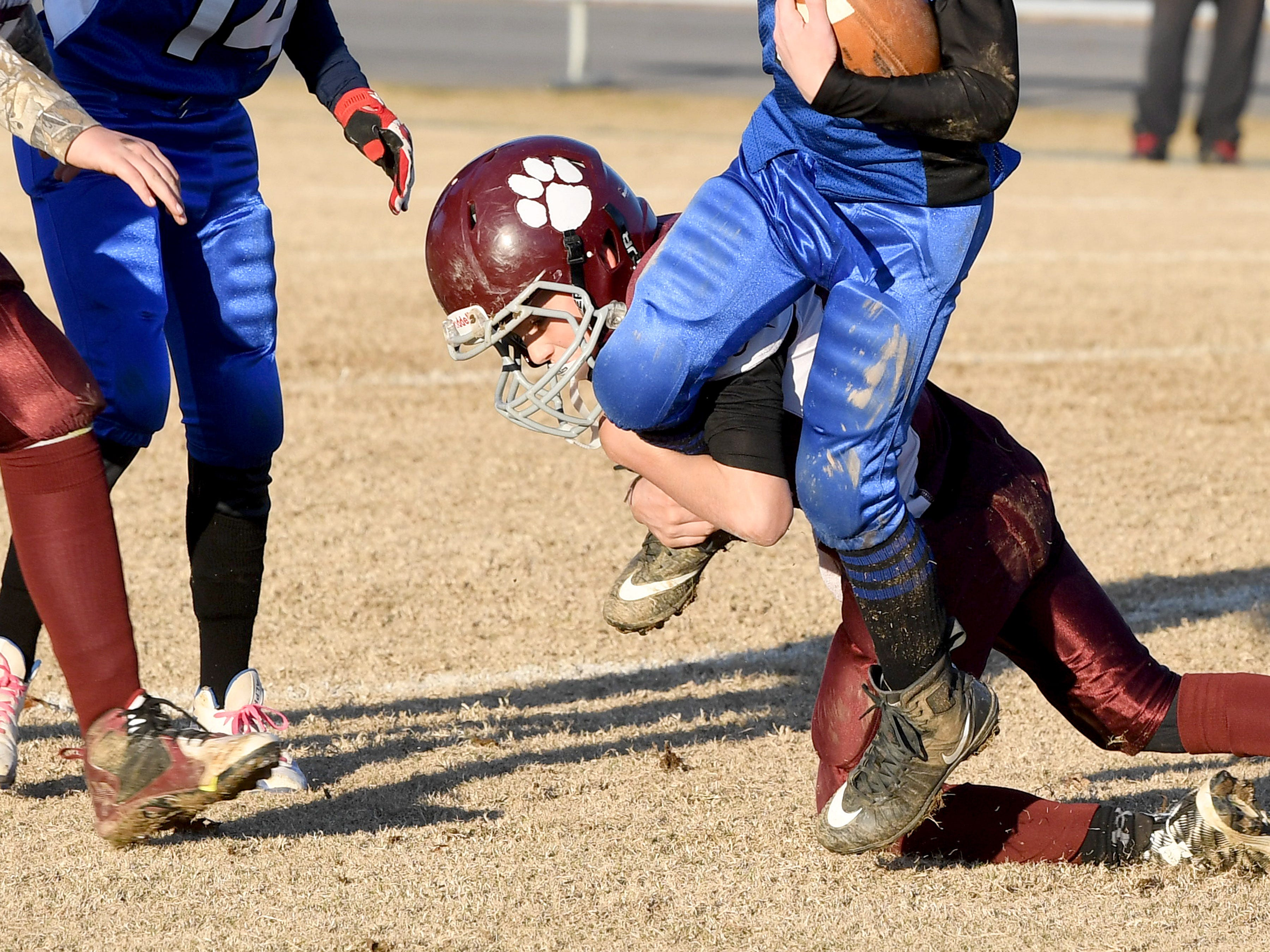 A Stuarts Draft defender grabs Fort Defiance ball carrier Bradley Hebb around the lower leg to make the stop during the Augusta County Quarterback Club Juniors Super Bowl in Fishersville on Sunday, Nov. 11, 2018. Fort Defiance beats Stuarts Draft, 13-12.