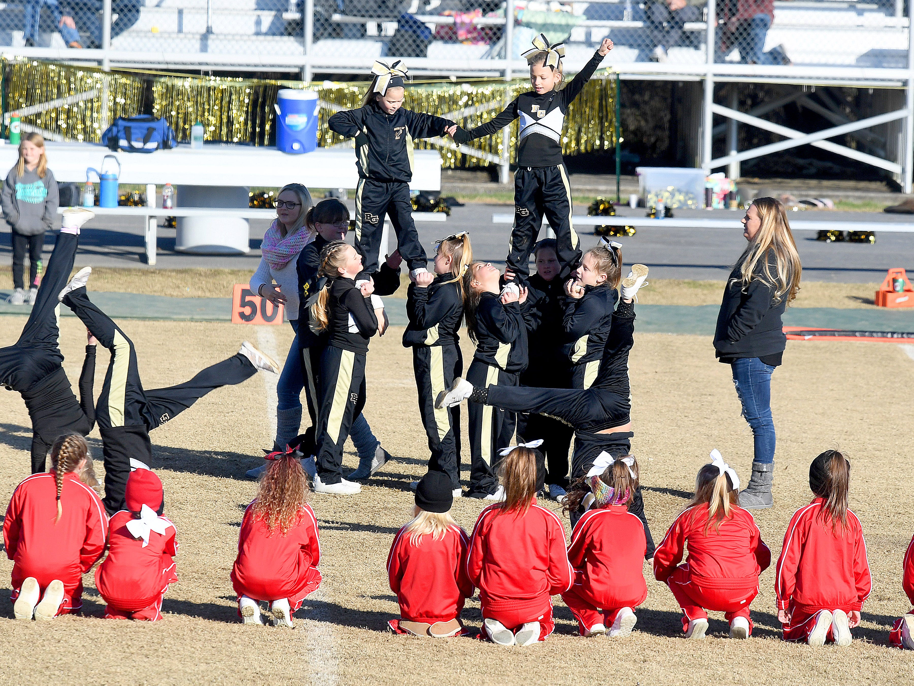 Buffalo Gap cheerleaders face-off against Riverheads cheerleaders during halftime of the Augusta County Quarterback Club Midget Super Bowl in Fishersville on Sunday, Nov. 11, 2018. Riverheads beat Buffalo Gap, 25-6.