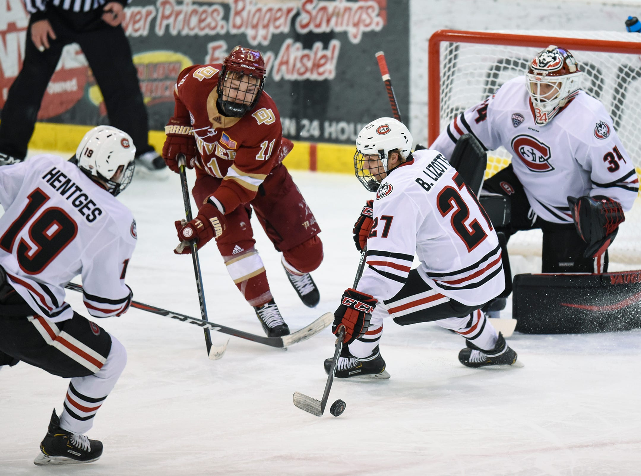 Blake Lizotte gets control of the puck in front of the St. Cloud State goal during the first period of the Saturday, Nov. 10, game against the University of Denver at the Herb Brooks National Hockey Center in St. Cloud.