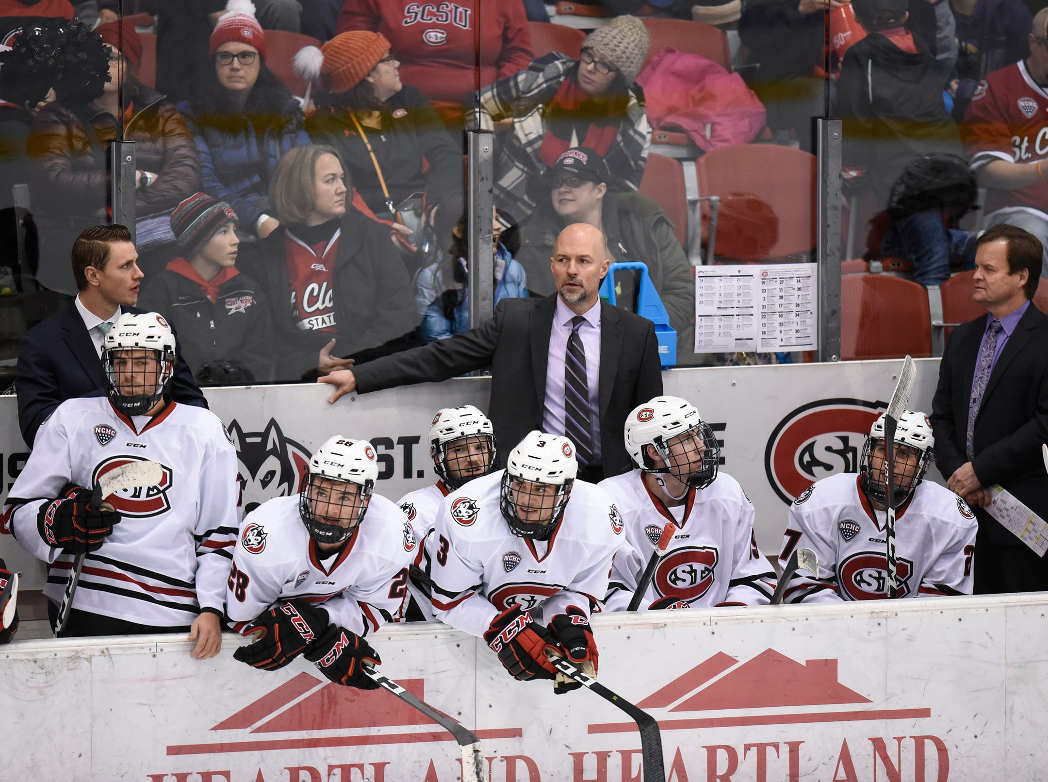 St. Cloud State head coach Brett Larson watches the action during the first period of the Saturday, Nov. 10, game against the University of Denver at the Herb Brooks National Hockey Center in St. Cloud.