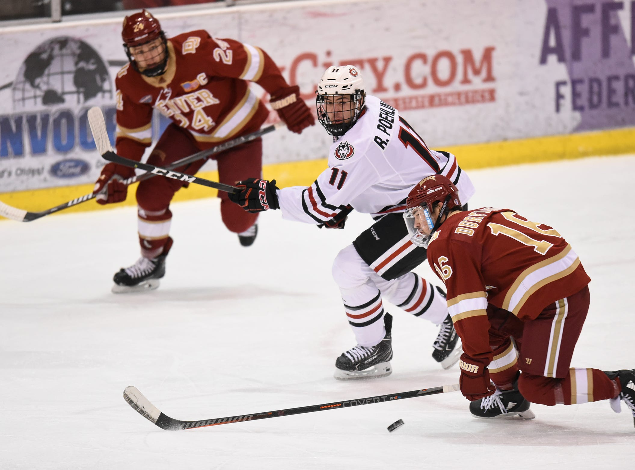 Ryan Poehling concentrates on the puck during the first period of the Saturday, Nov. 10, game against the University of Denver at the Herb Brooks National Hockey Center in St. Cloud.