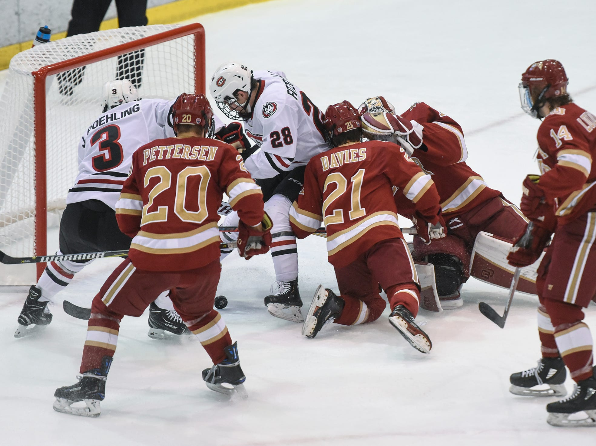 Players converge in front of the Denver goal during the first period of the Saturday, Nov. 10, game at the Herb Brooks National Hockey Center in St. Cloud.