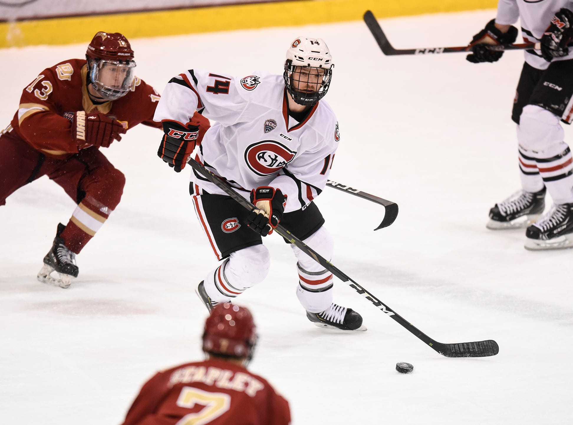 Patrick Newell skates with the puck during the first period of the Saturday, Nov. 10, game against the University of Denver at the Herb Brooks National Hockey Center in St. Cloud.
